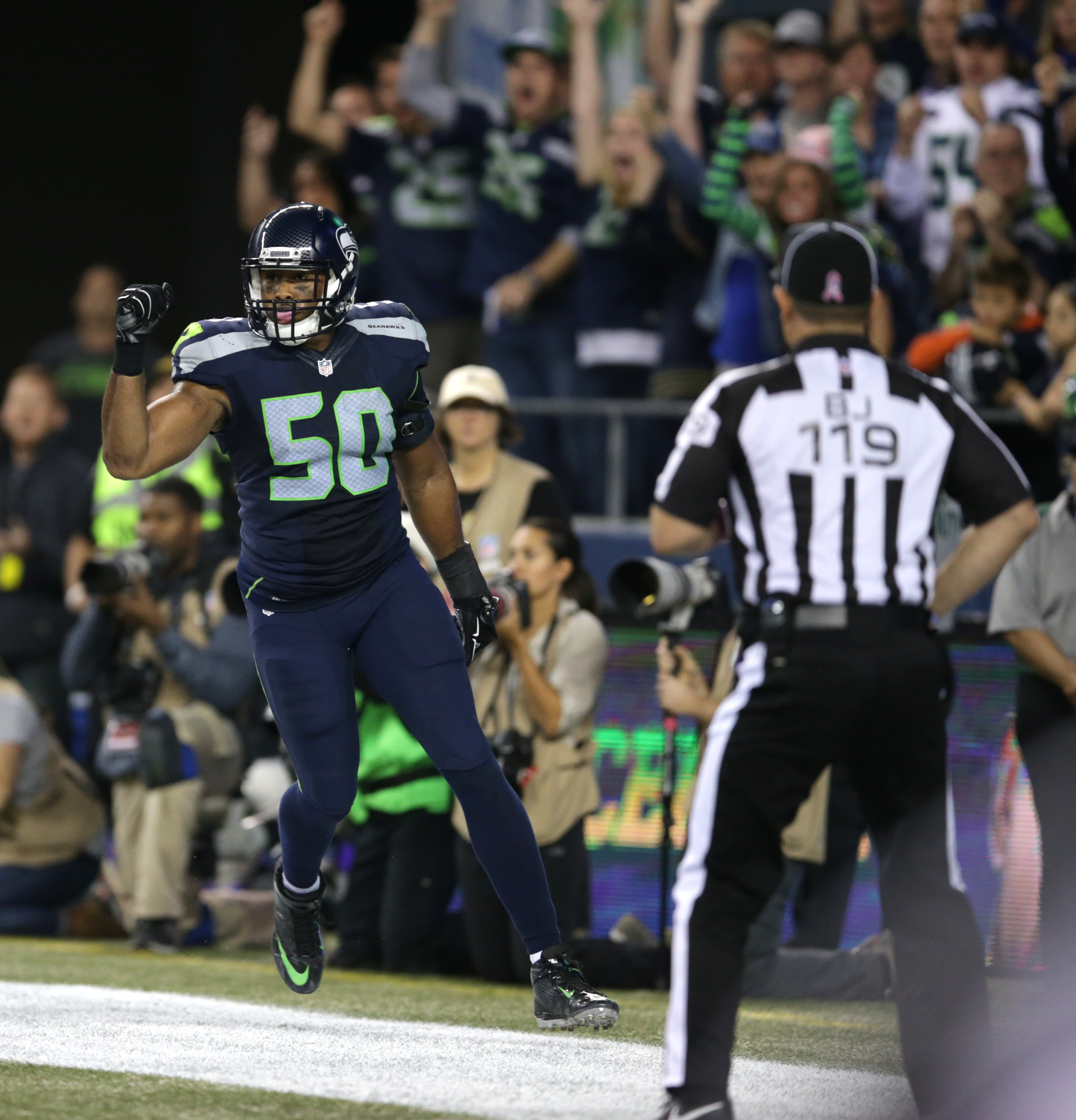 Seattle Seahawks outside linebacker K.J. Wright (50) celebrates after a play late in the fourth quarter of an NFL football game between the Seattle Seahawks and the Detroit Lions that was ruled a touchback after Lions wide receiver Calvin Johnson fumbled