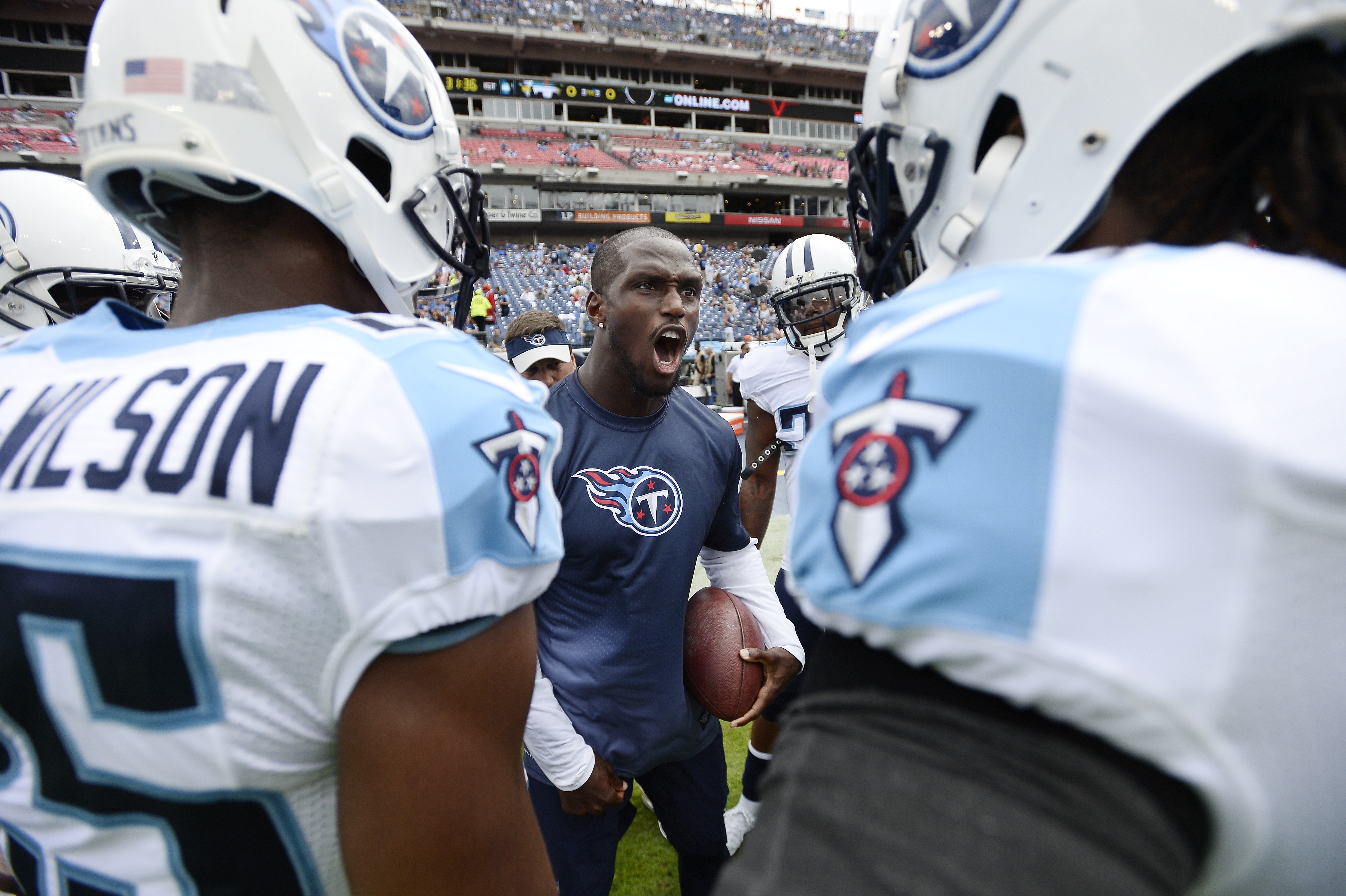 FILE - In this Sept. 27, 2015, file photo, Tennessee Titans cornerback Jason McCourty, center, pumps up teammates before an NFL football game against the Indianapolis Colts in Nashville, Tenn. McCourty finally is ready for his season debut. The Titans cor