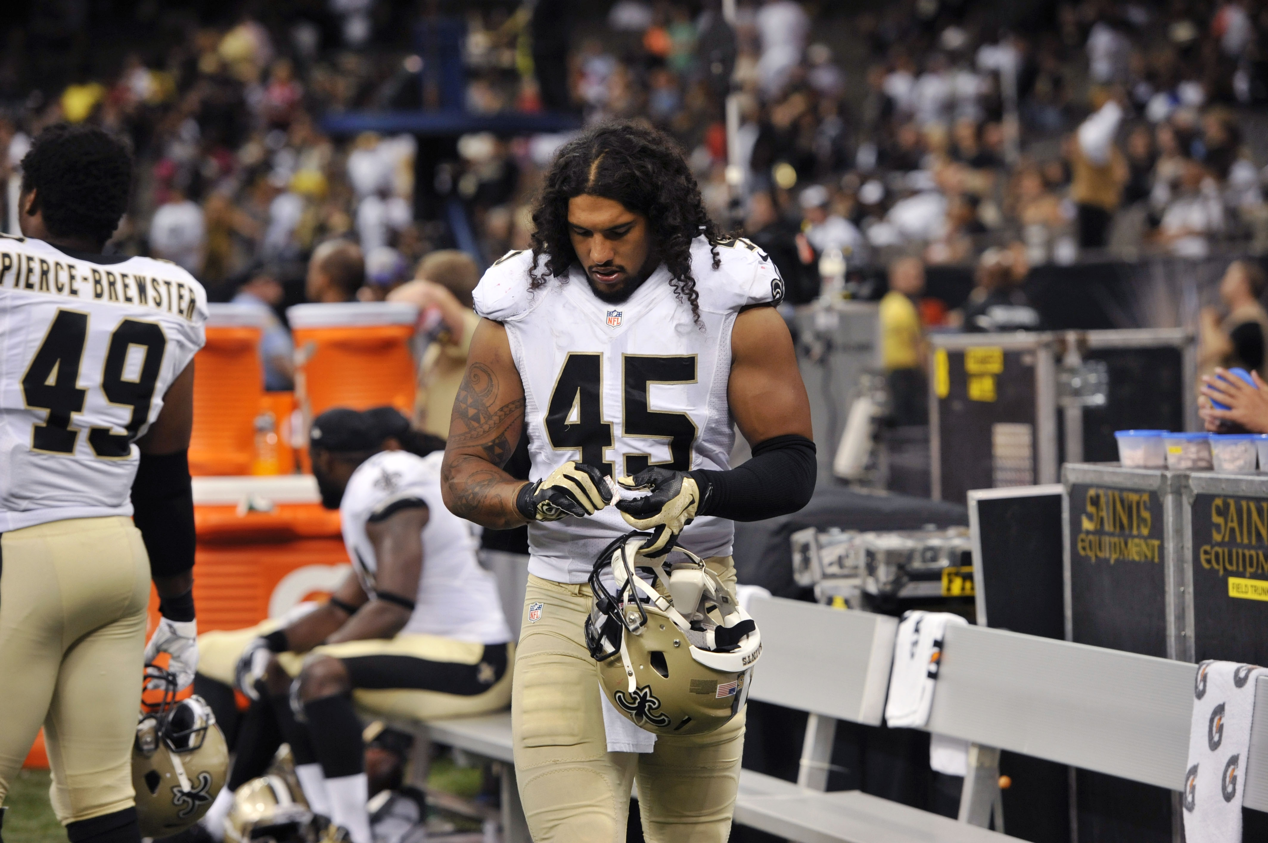 In this Aug. 22, 2015, photo, New Orleans Saints outside linebacker Hau'oli Kikaha (45) walks on the sideline in the second half of an NFL preseason football game against the New England Patriots in New Orleans. Kikaha projects a laid back, island vibe as