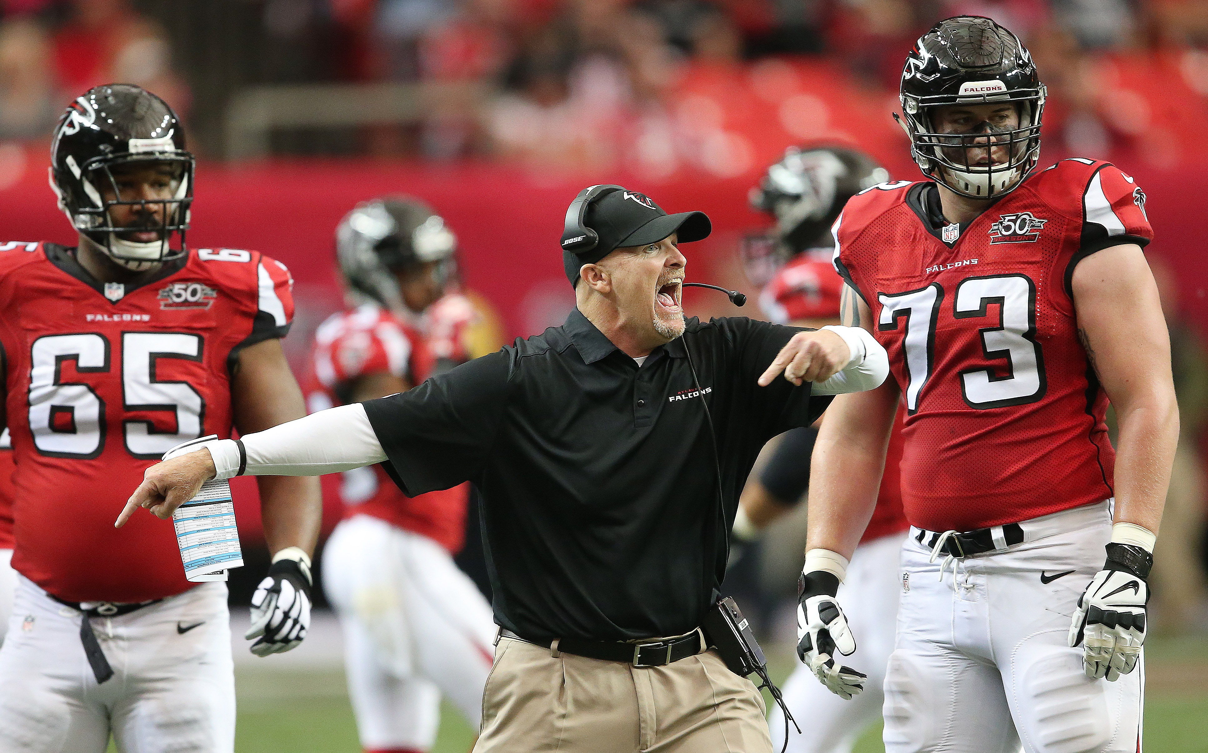 Atlanta Falcons head coach Dan Quinn speaks to his team after the Washington Redskins intercepted the ball during the first half of an NFL football game, Sunday, Oct. 11, 2015, in Atlanta. (AP Photo/John Bazemore)