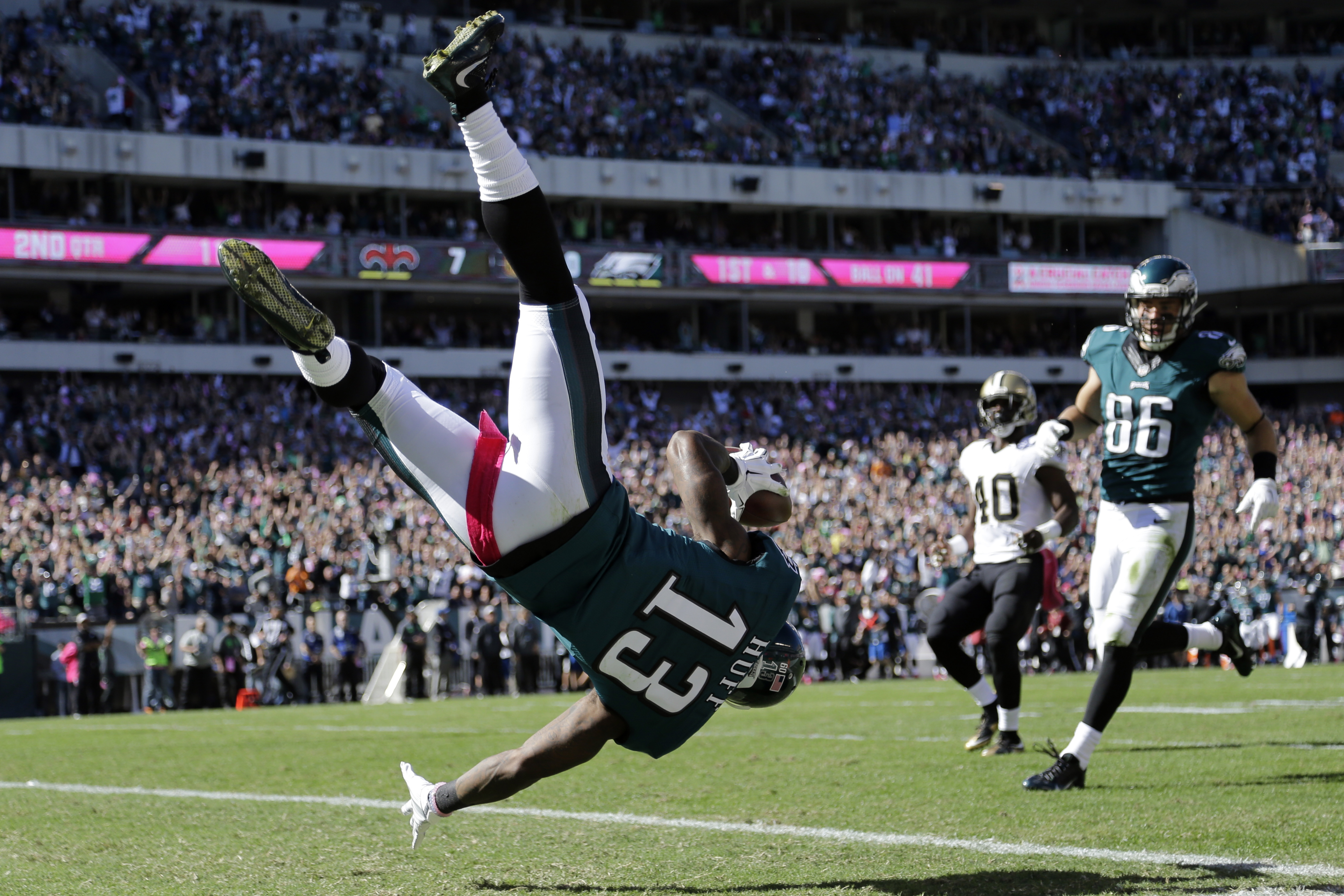 Philadelphia Eagles' Josh Huff flips into the end zone for a touchdown during the first half of an NFL football game against the New Orleans Saints, Sunday, Oct. 11, 2015, in Philadelphia. (AP Photo/Matt Rourke)