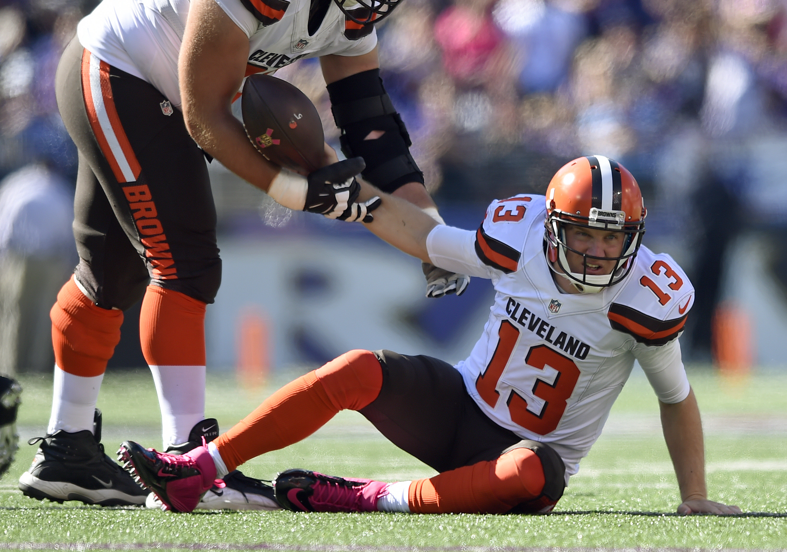 Cleveland Browns quarterback Josh McCown (13) is assisted to his feet after being sacked in the first half of an NFL football game against the Baltimore Ravens, Sunday, Oct. 11, 2015, in Baltimore. (AP Photo/Gail Burton)