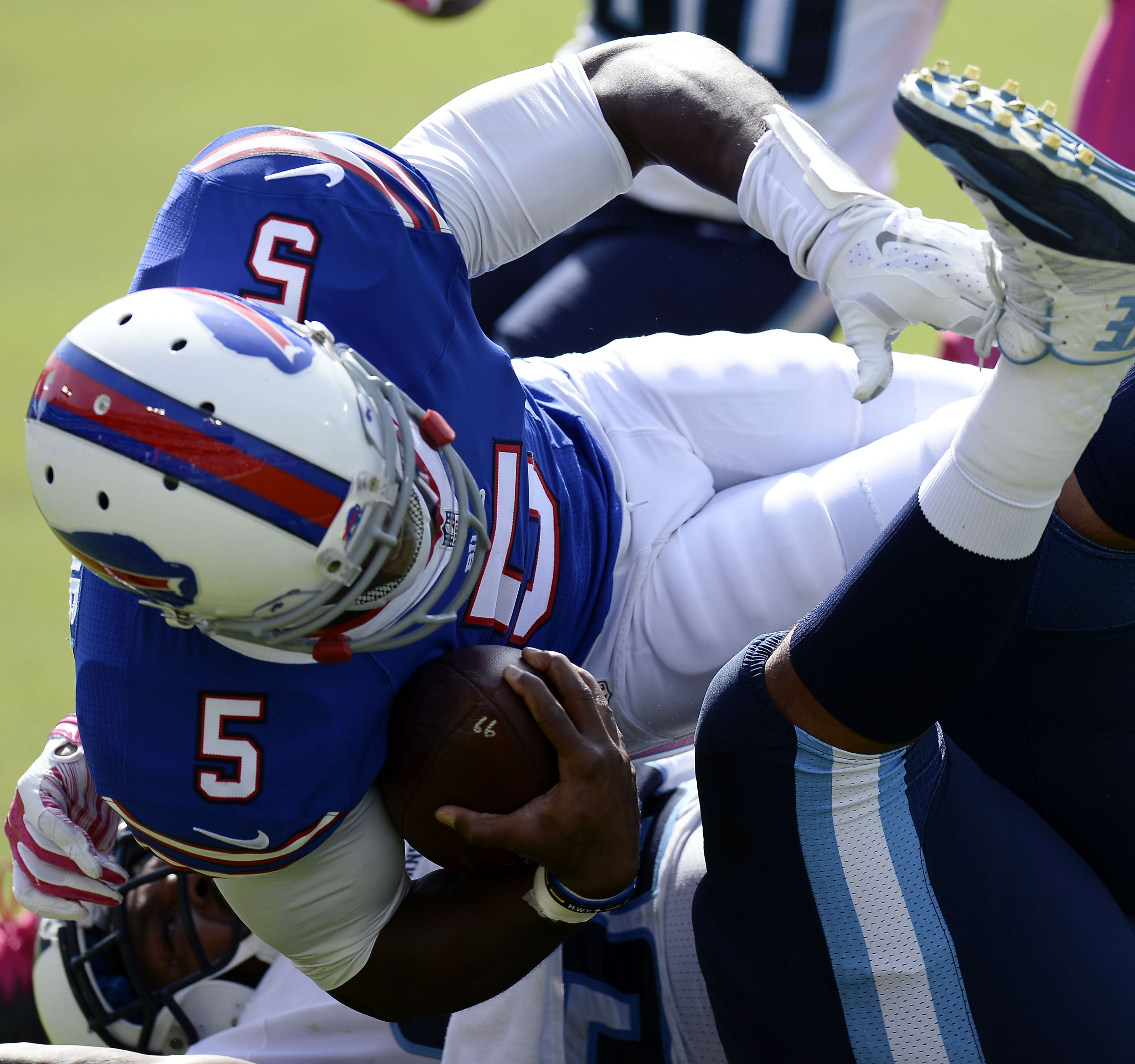 Buffalo Bills quarterback Tyrod Taylor (5) is brought down in the first half of an NFL football game against the Tennessee Titans, Sunday, Oct. 11, 2015, in Nashville, Tenn. (AP Photo/Mark Zaleski)