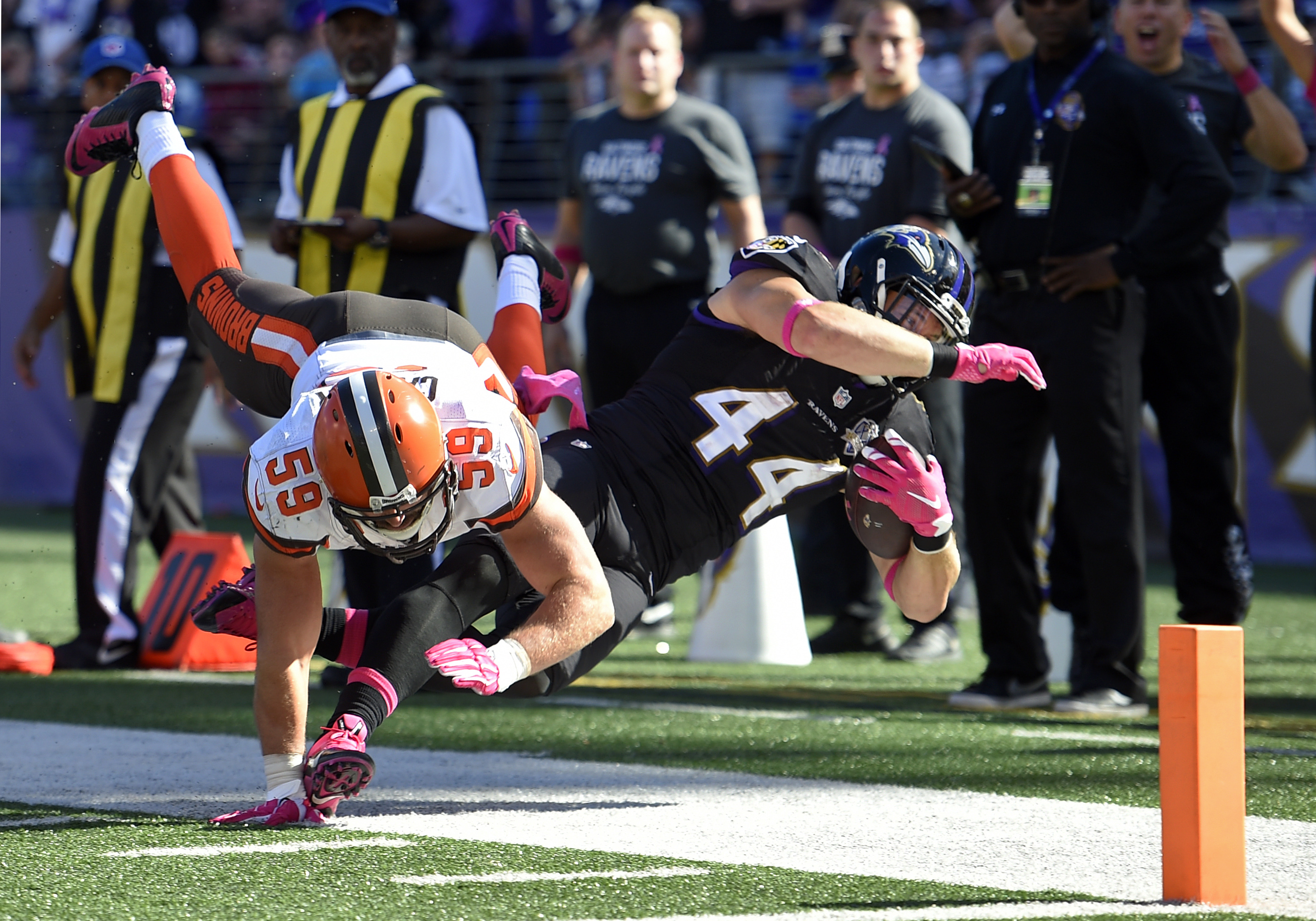 Baltimore Ravens fullback Kyle Juszczyk, right, is knocked out of bounds by Cleveland Browns inside linebacker Tank Carder just short of the end zone in the second half of an NFL football game, Sunday, Oct. 11, 2015, in Baltimore. (AP Photo/Nick Wass)