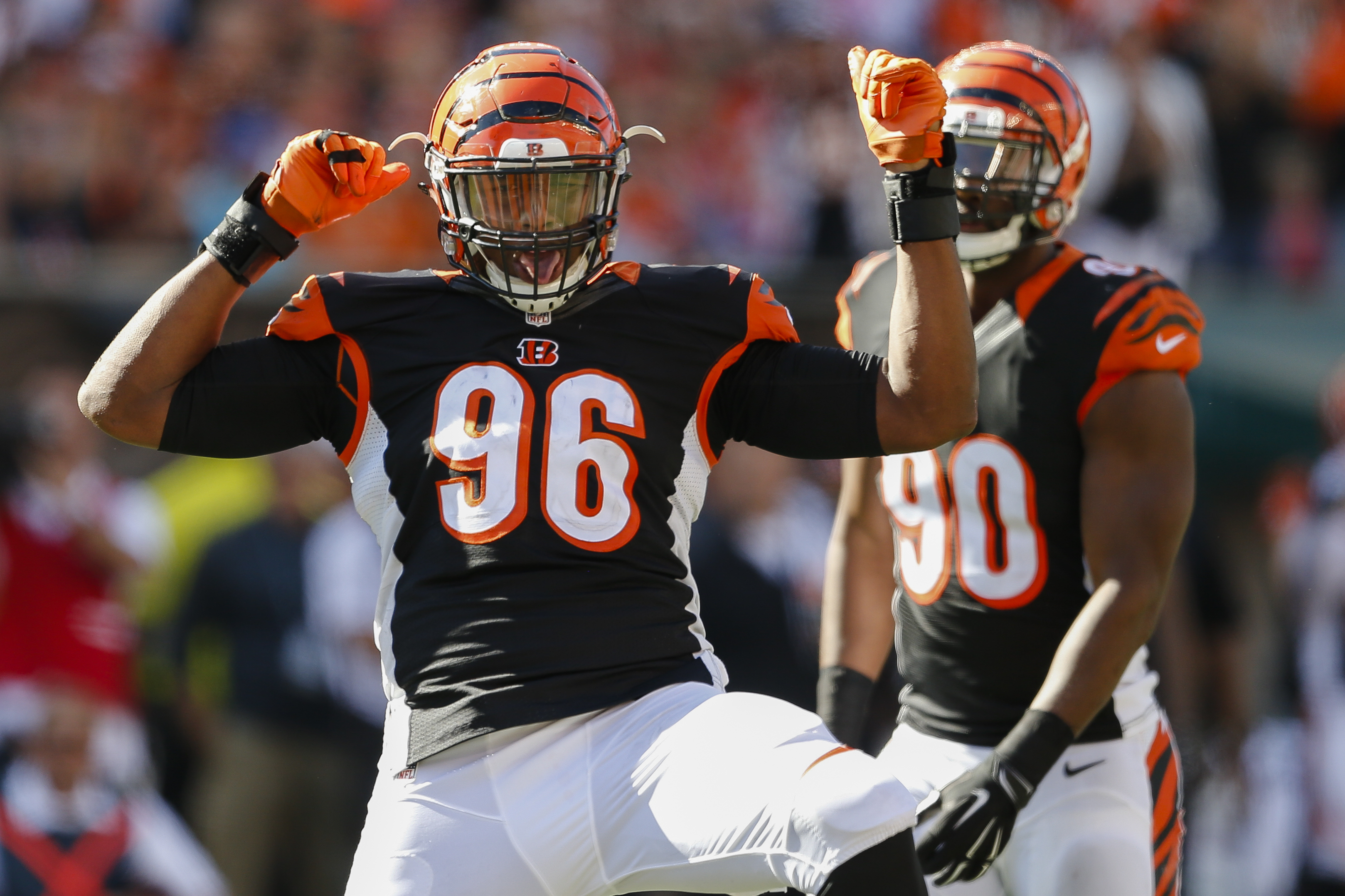 Cincinnati Bengals defensive end Carlos Dunlap (96) reacts after sacking Seattle Seahawks quarterback Russell Wilson (not shown) in the second half of an NFL football game, Sunday, Oct. 11, 2015, in Cincinnati. (AP Photo/Gary Landers)