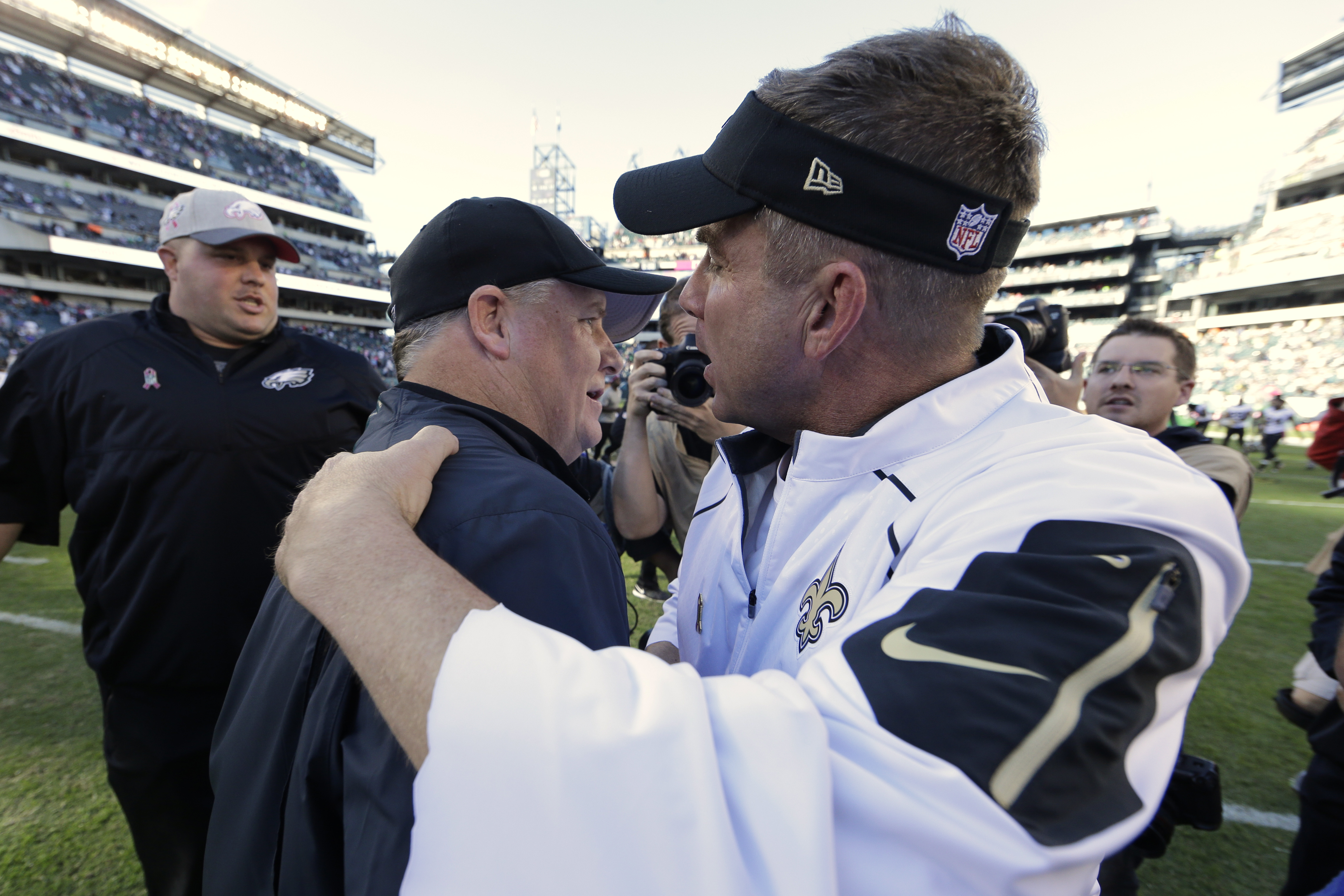 New Orleans Saints head coach Sean Payton, right, and Philadelphia Eagles head coach Chip Kelly meet after an NFL football game, Sunday, Oct. 11, 2015, in Philadelphia. Philadelphia won 39-17. (AP Photo/Matt Rourke)