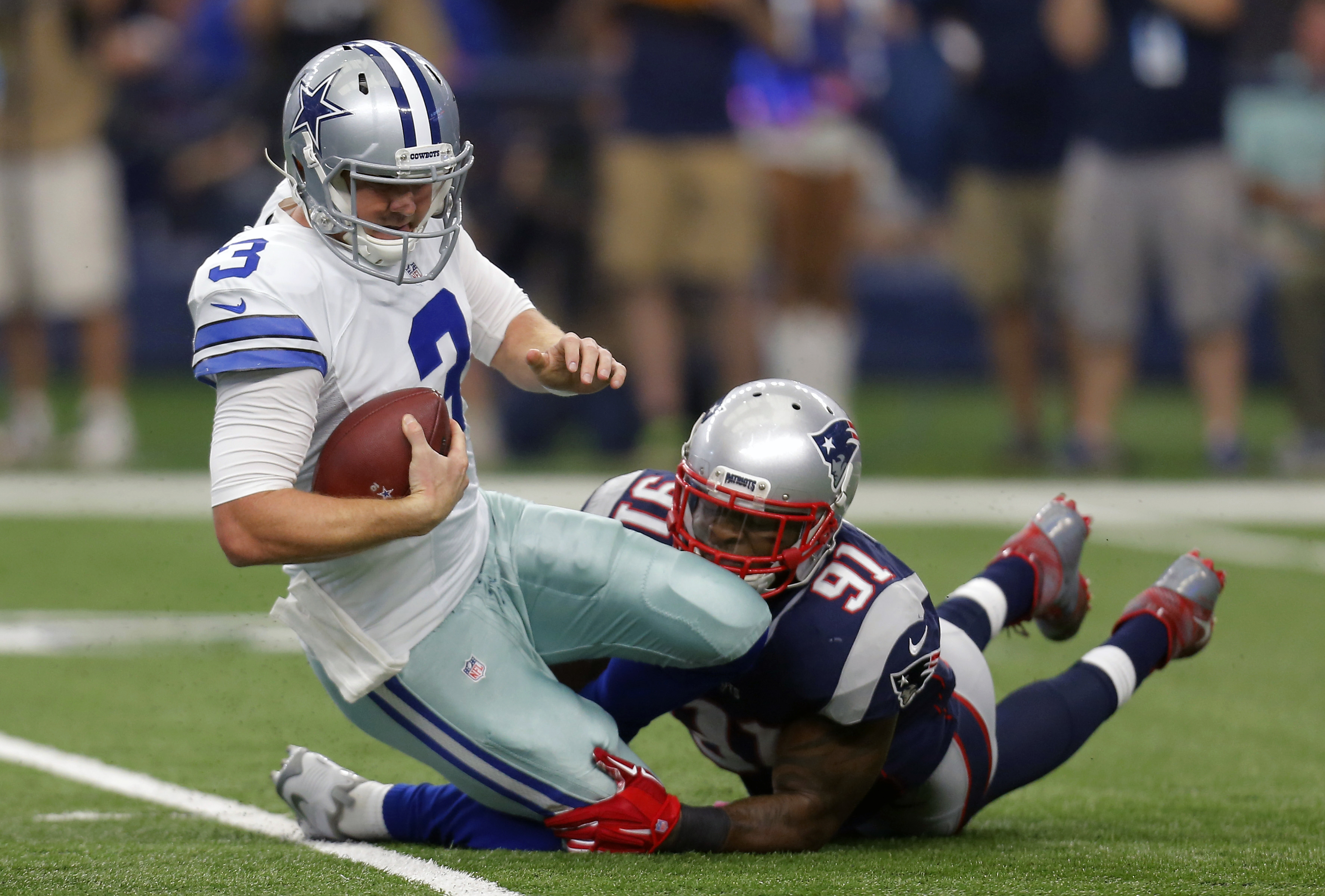 Dallas Cowboys' Brandon Weeden (3) is sacked by New England Patriots' Jamie Collins (91) during the first quarter of an NFL football game, Sunday, Oct. 11, 2015, in Arlington, Texas. (AP Photo/Brandon Wade)