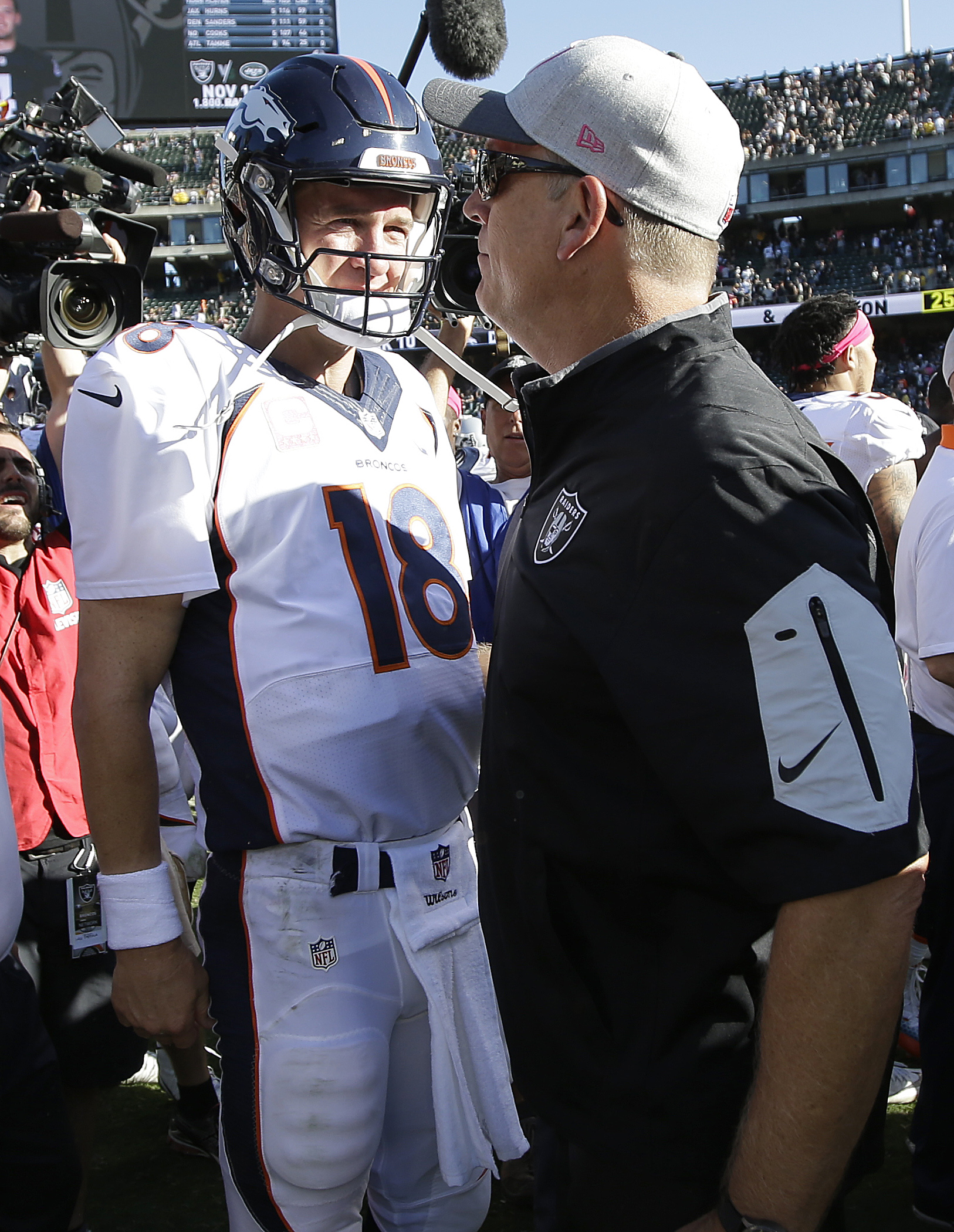 Denver Broncos quarterback Peyton Manning (18) greets Oakland Raiders head coach Jack Del Rio after an NFL football game in Oakland, Calif., Sunday, Oct. 11, 2015. The Broncos won 16-10. (AP Photo/Marcio Jose Sanchez)