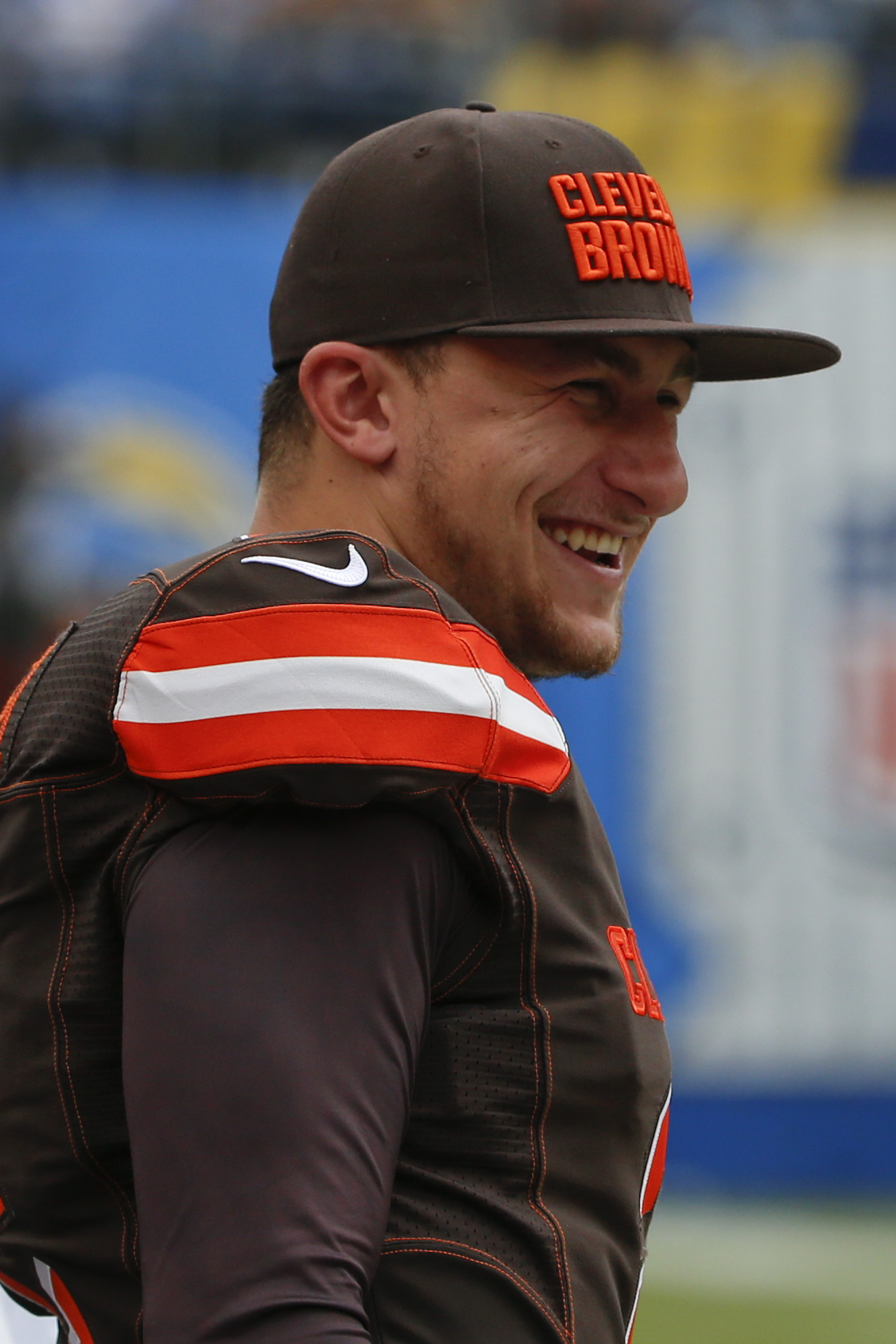 Cleveland Browns quarterback Johnny Manziel looks on from the sidelines as the Browns play the San Diego Chargers during the first half in an NFL football game Sunday, Oct. 4, 2015, in San Diego. (AP Photo/Lenny Ignelzi)
