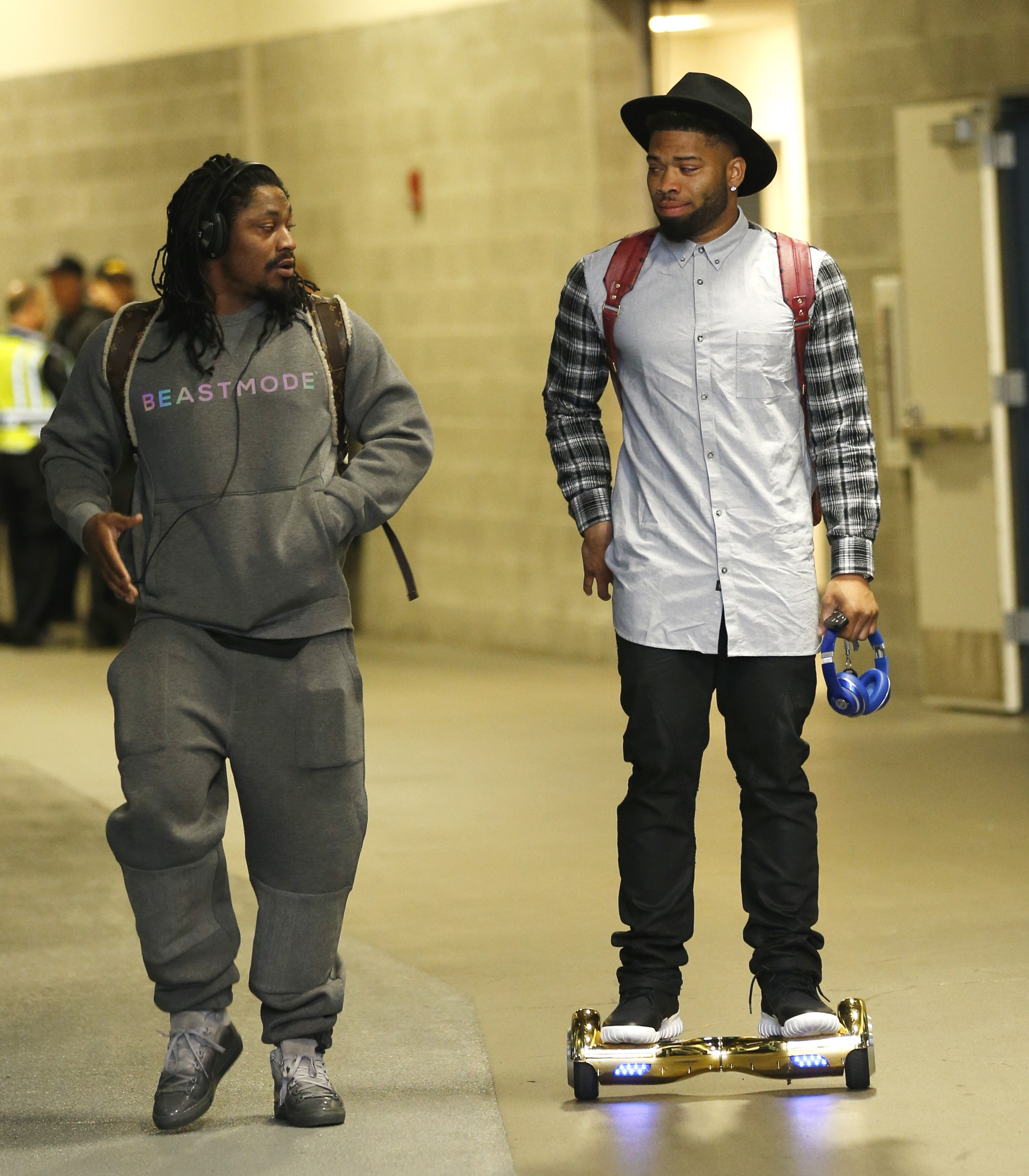 Seattle Seahawks running back Marshawn Lynch, left, and wide receiver B.J. Daniels, right, arrive for an NFL football game against the Carolina Panthers, Sunday, Oct. 18, 2015, in Seattle. (AP Photo/Stephen Brashear)