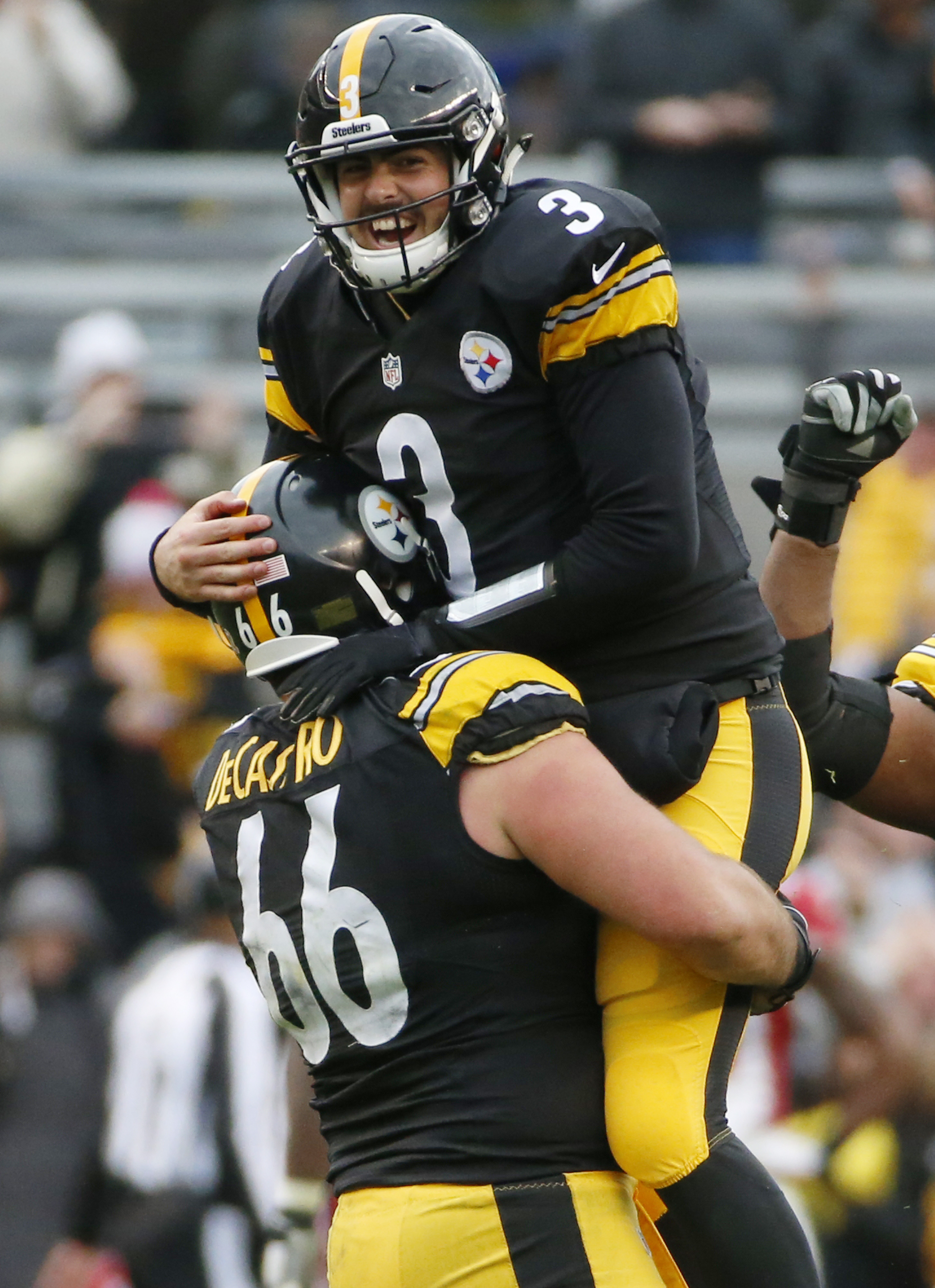 Pittsburgh Steelers quarterback Landry Jones (3) celebrates with guard David DeCastro (66) after throwing a touchdown pass to wide receiver Martavis Bryant (10) in the fourth quarter an NFL football game against the Arizona Cardinals, Sunday, Oct. 18, 201