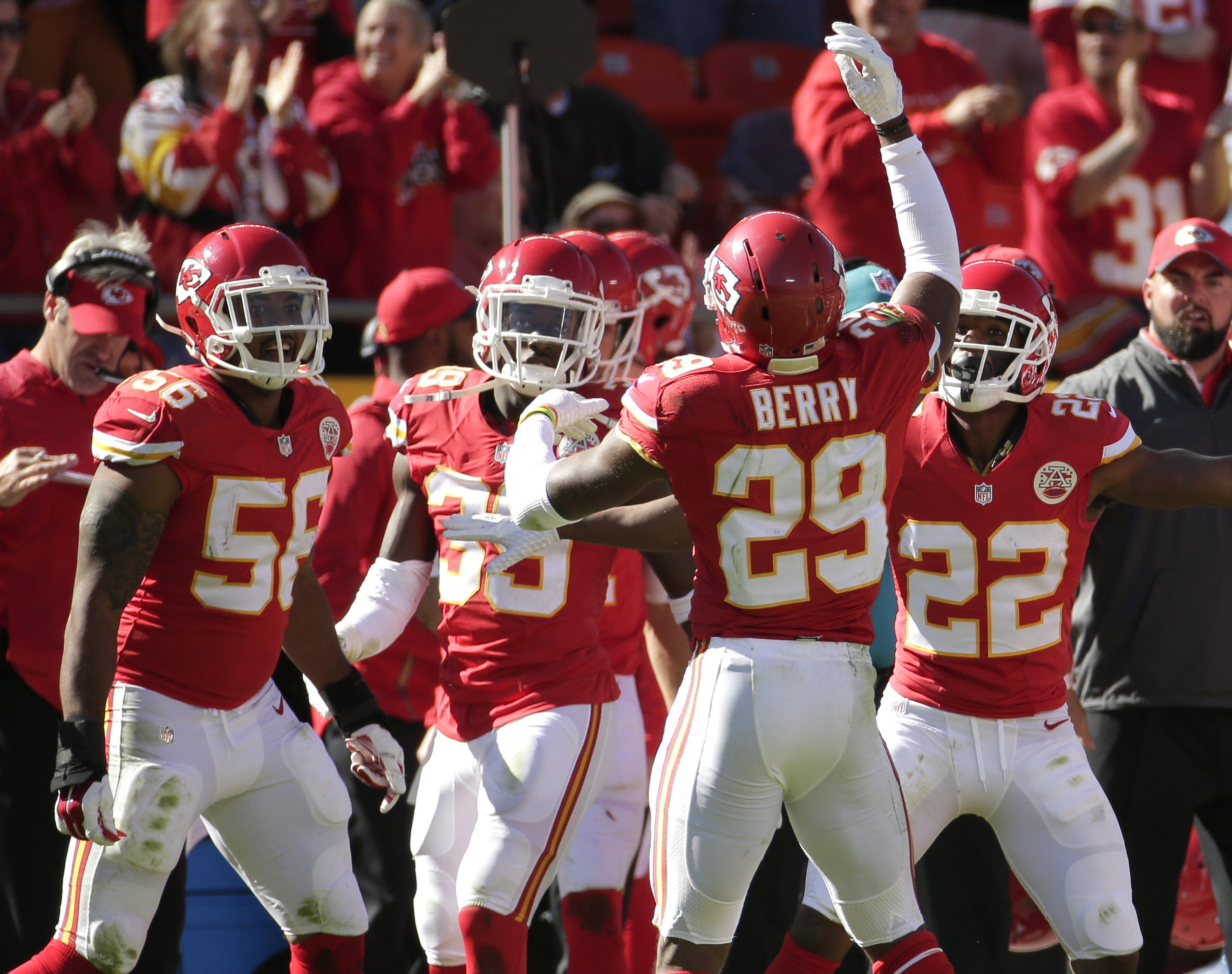 Kansas City Chiefs defensive back Eric Berry (29) celebrates with teammates after he intercepted a ball from Pittsburgh Steelers quarterback Landry Jones for a turnover during the second half of an NFL football game in Kansas City, Mo., Sunday, Oct. 25, 2