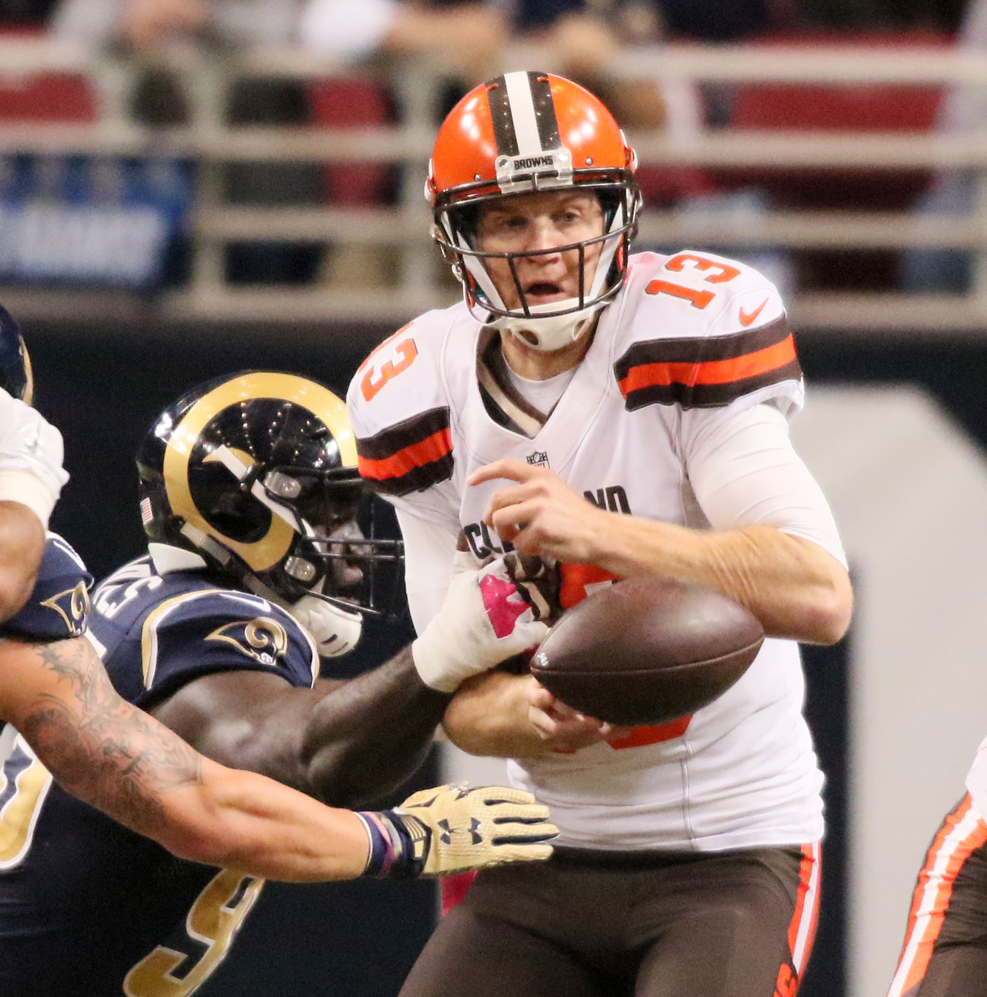 Cleveland Browns quarterback Josh McCown fumbles the ball as he is sacked by St. Louis Rams defensive end William Hayes, left, in the first quarter of an NFL football game on Sunday, Oct. 25, 2015, in St. Louis.  The fumble was recovered by Rams linebacke