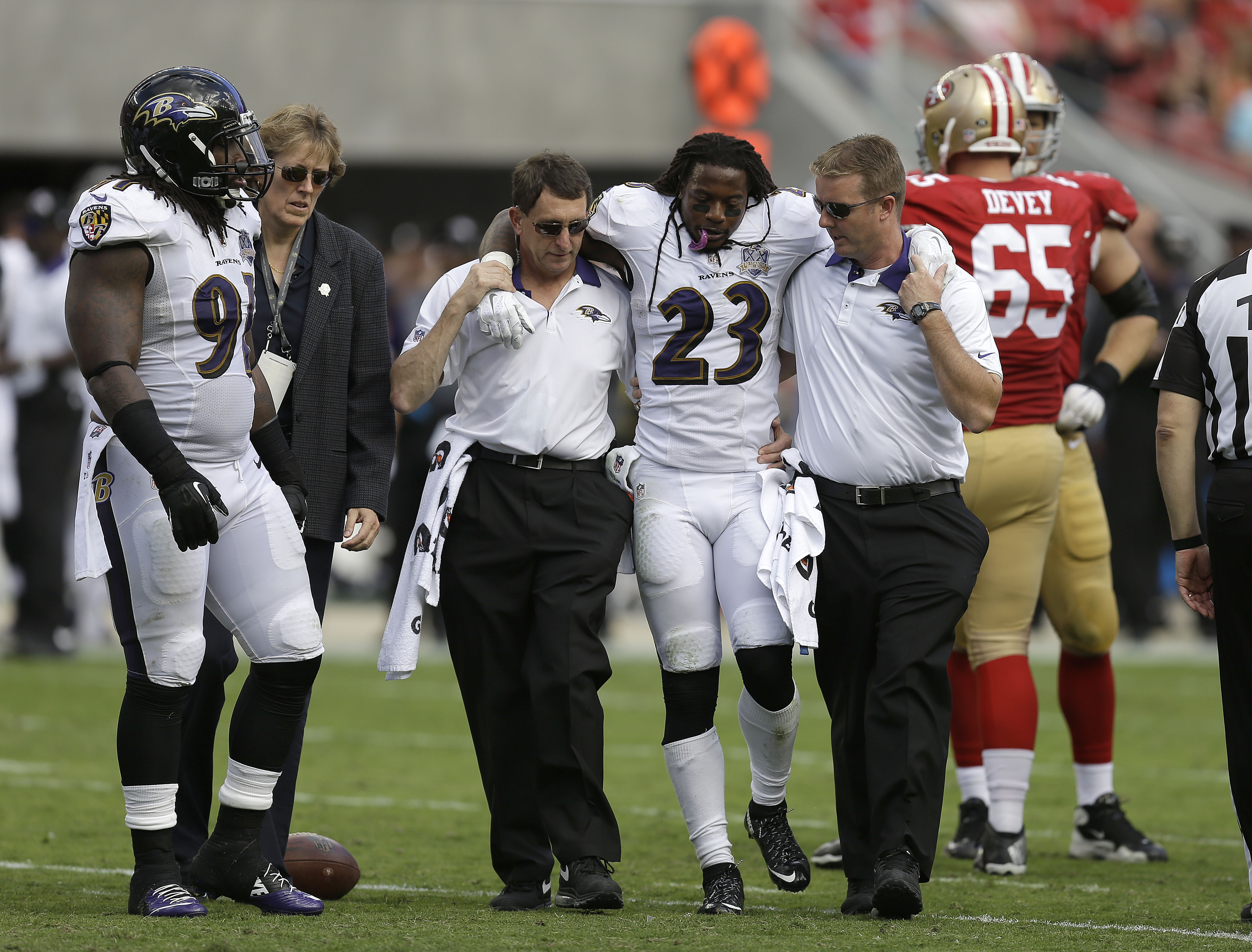 Baltimore Ravens free safety Kendrick Lewis (23) is helped off the field during the second half of an NFL football game against the San Francisco 49ers in Santa Clara, Calif., Sunday, Oct. 18, 2015. (AP Photo/Ben Margot)