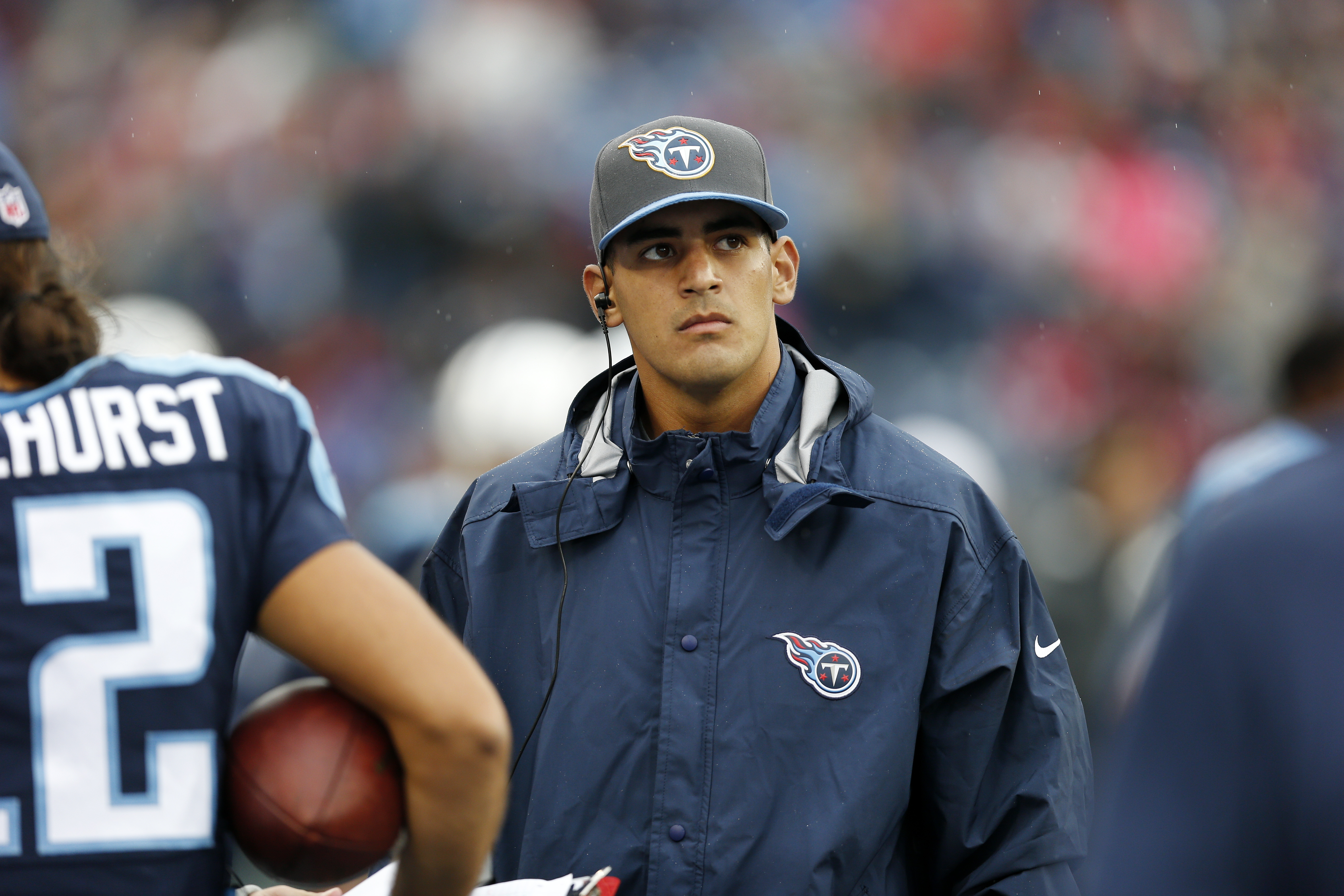 FILE - In this Oct. 25, 2015, file photo, injured Tennessee Titans quarterback Marcus Mariota watches the scoreboard in the second half of an NFL football game against the Atlanta Falcons in Nashville, Tenn. Mariota has been able to practice in a limited