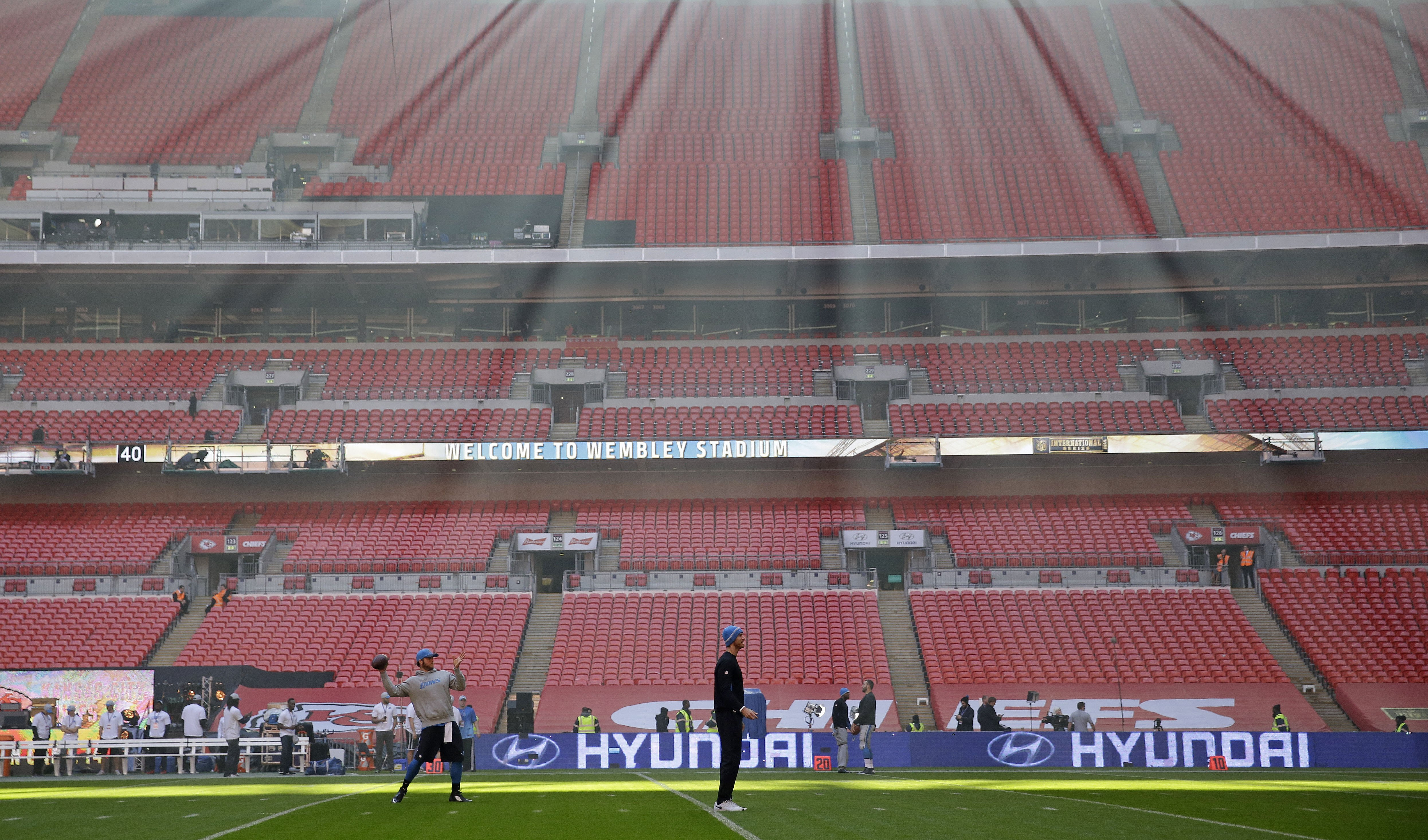 Sunlight filters through as Detroit Lions quarterback Matthew Stafford (9) passes the ball during the warm-up before the NFL football game between Detroit Lions and Kansas City Chiefs Wembley Stadium in London,  Sunday, Nov. 1, 2015. (AP Photo/Matt Dunham
