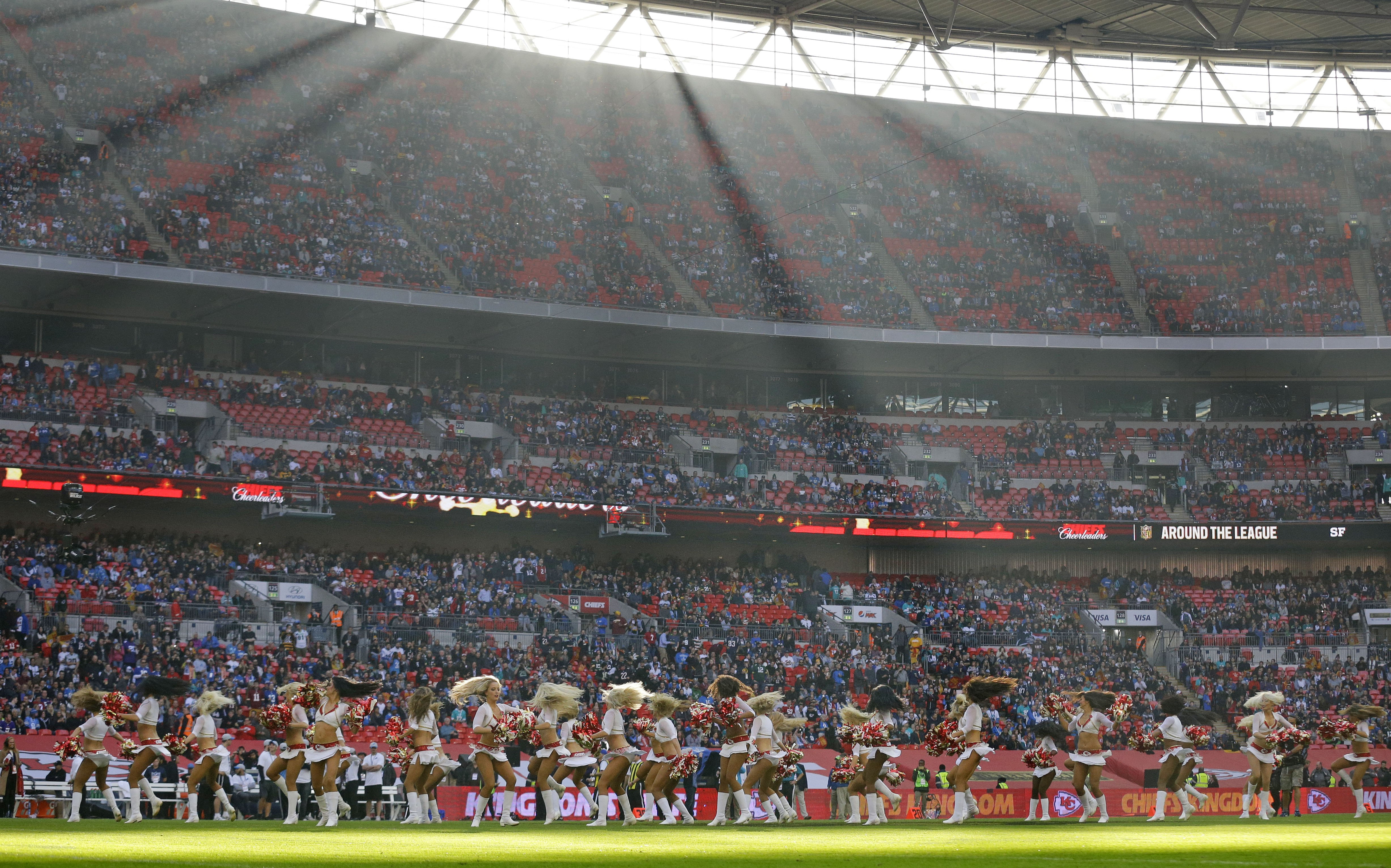 Cheerleaders perform before the NFL football game between Detroit Lions and Kansas City Chiefs Wembley Stadium in London,  Sunday, Nov. 1, 2015. (AP Photo/Matt Dunham)