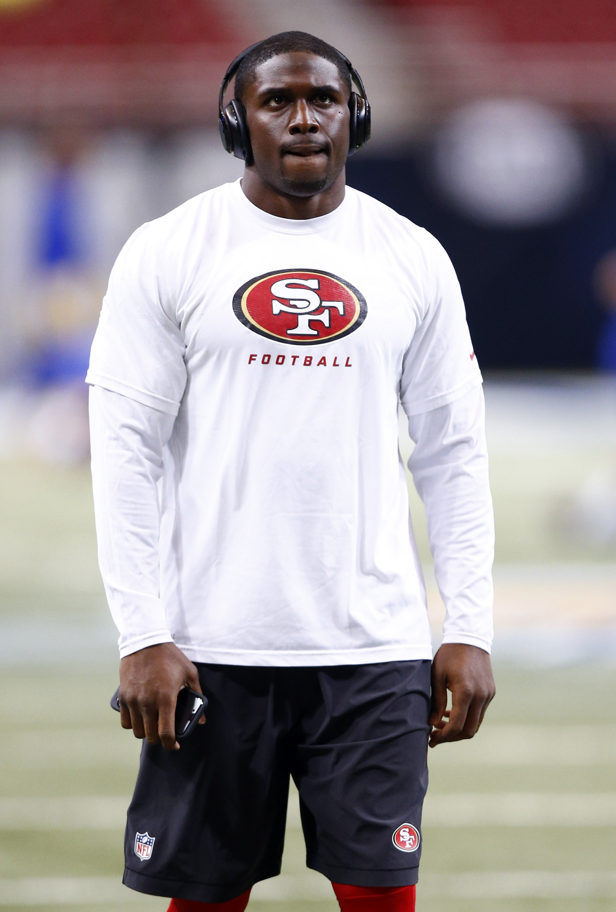 San Francisco 49ers running back Reggie Bush warms up before the start of an NFL football game between the St. Louis Rams and the San Francisco 49ers Sunday, Nov. 1, 2015, in St. Louis. (AP Photo/Billy Hurst)