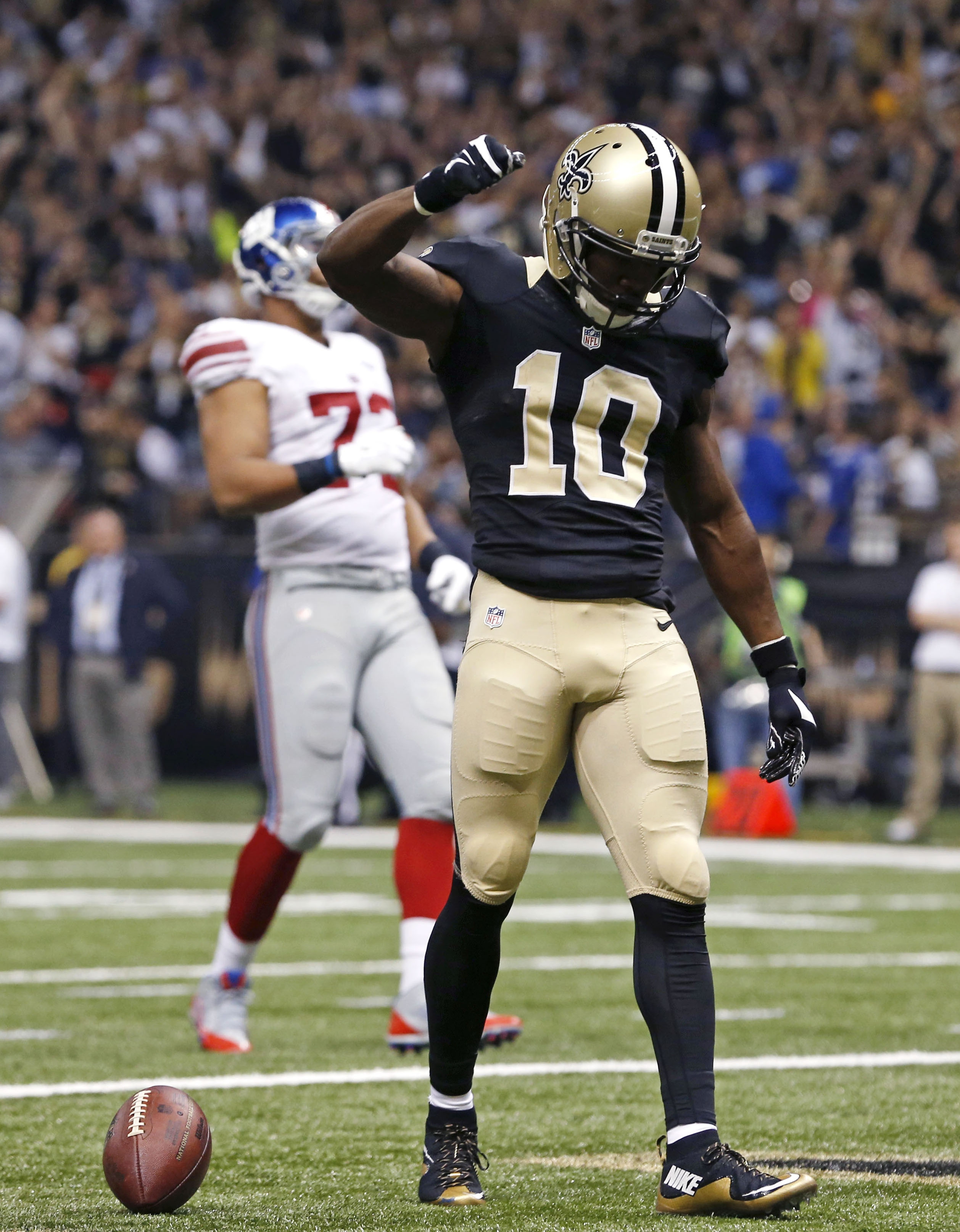 New Orleans Saints wide receiver Brandin Cooks (10) celebrates his touchdown reception in the first half of an NFL football game against the New York Giants in New Orleans, Sunday, Nov. 1, 2015. (AP Photo/Jonathan Bachman)