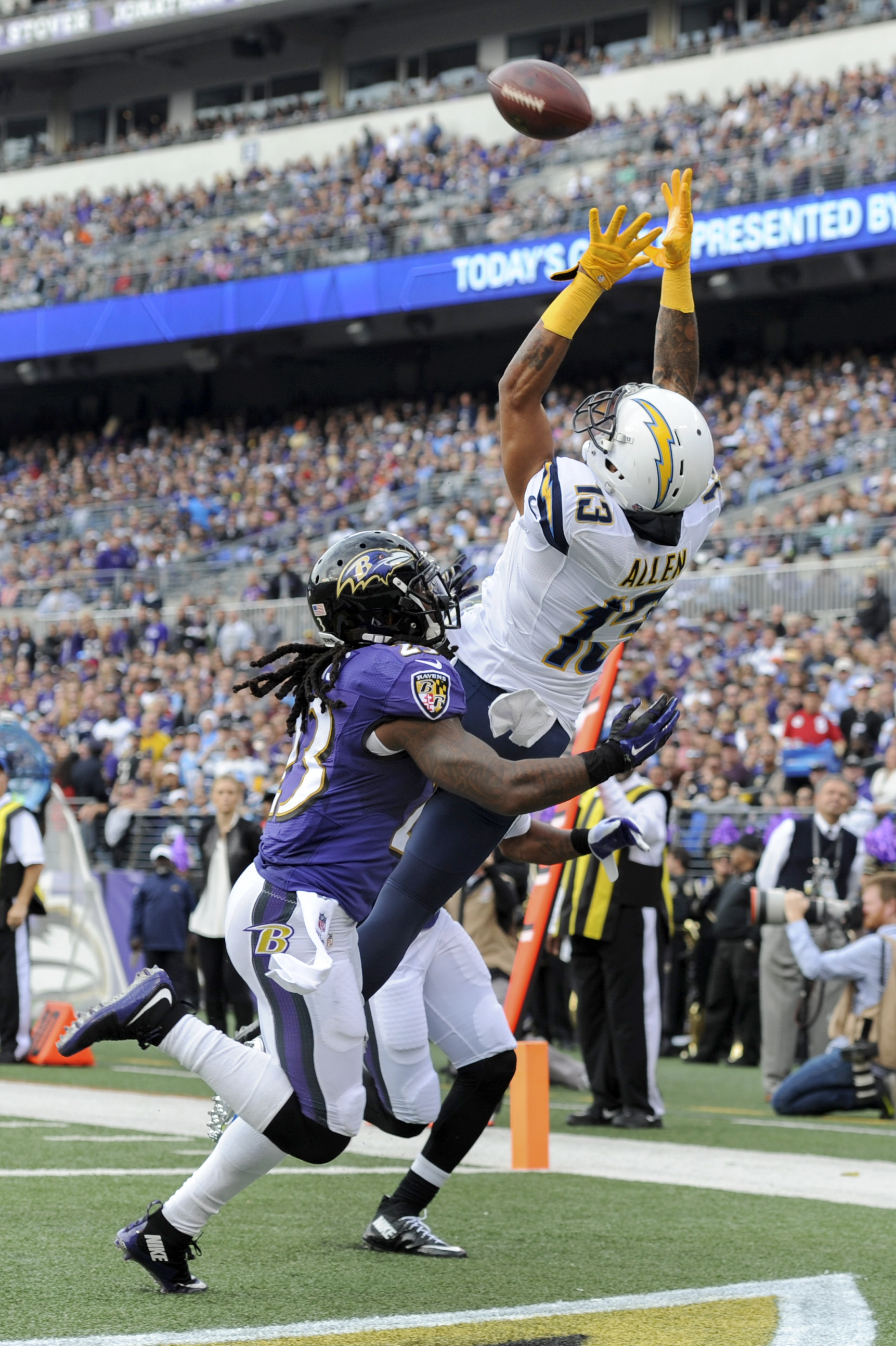 San Diego Chargers wide receiver Keenan Allen (13) pulls in a touchdown pass under pressure from Baltimore Ravens free safety Kendrick Lewis (23) during the first half of an NFL football game in Baltimore, Sunday, Nov. 1, 2015. (AP Photo/Gail Burton)