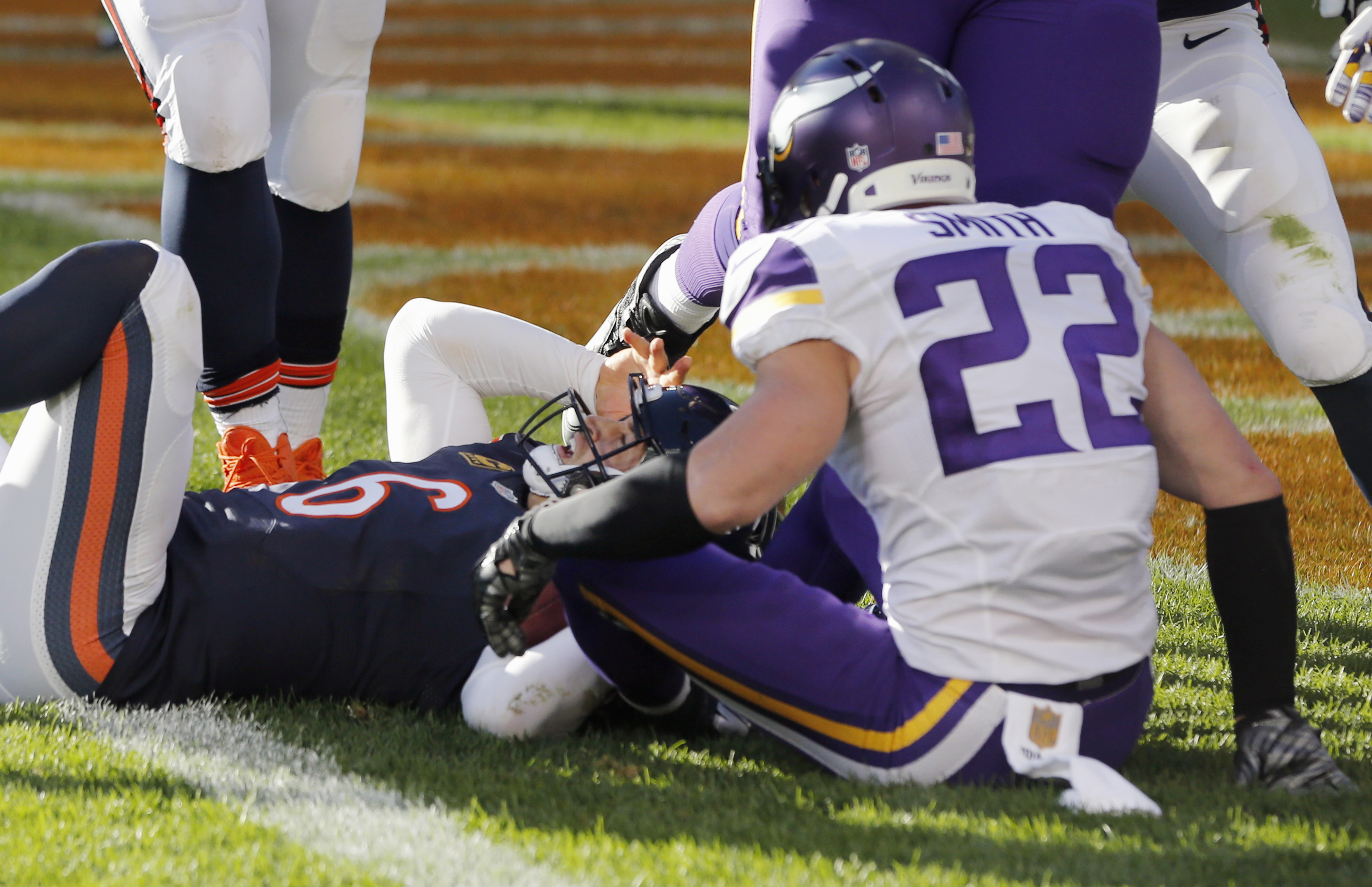 Chicago Bears quarterback Jay Cutler (6) reacts after diving into the end zone for a touchdown against Minnesota Vikings safety Harrison Smith (22) during the second half of an NFL football game, Sunday, Nov. 1, 2015, in Chicago. (AP Photo/Charles Rex Arb