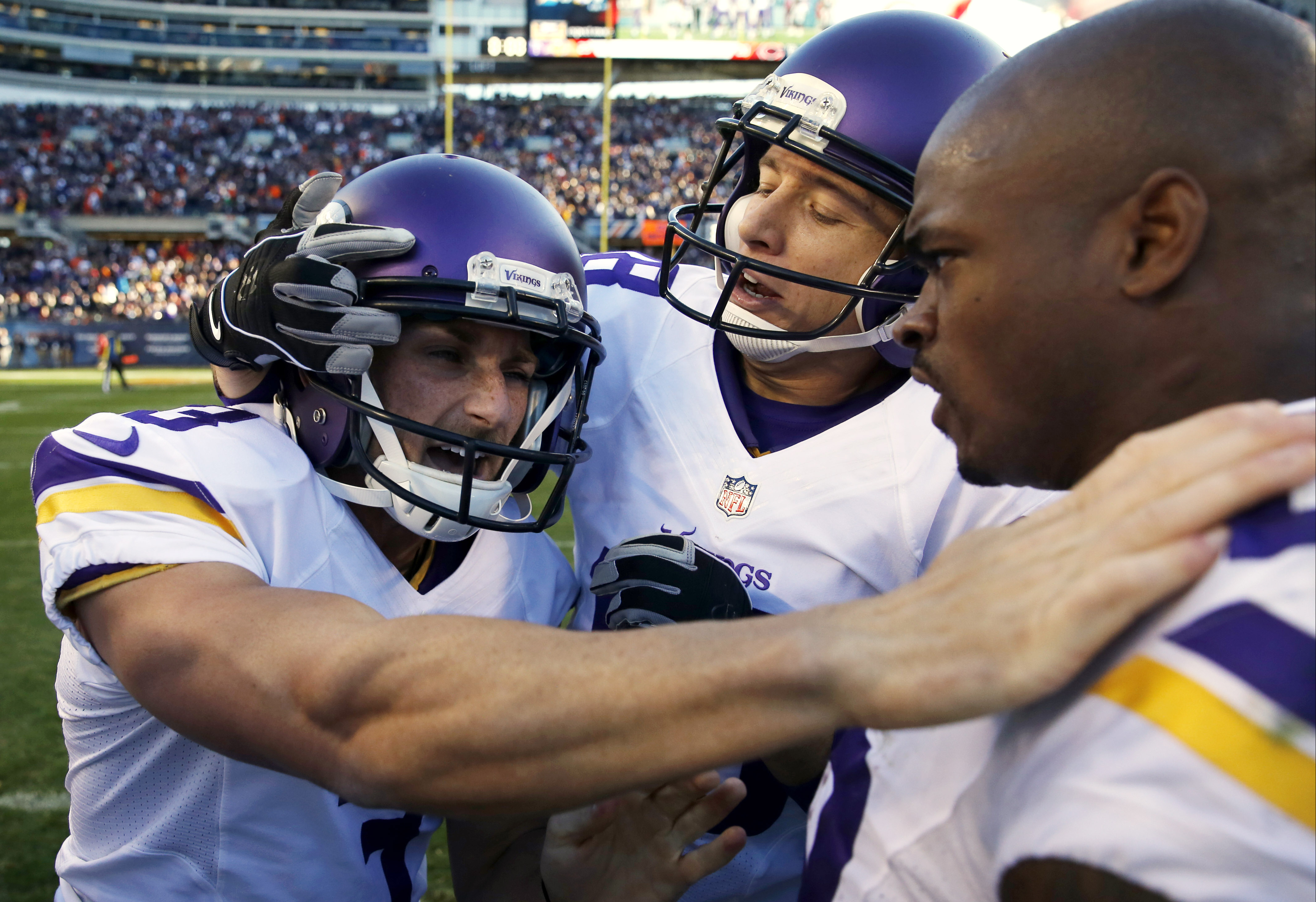 Minnesota Vikings kicker Blair Walsh (3) celebrates his game winning field goal with Jeff Locke, center, and Adrian Peterson (28) during the second half of an NFL football game, Sunday, Nov. 1, 2015, in Chicago. The Vikings won 23-20. (AP Photo/Charles Re