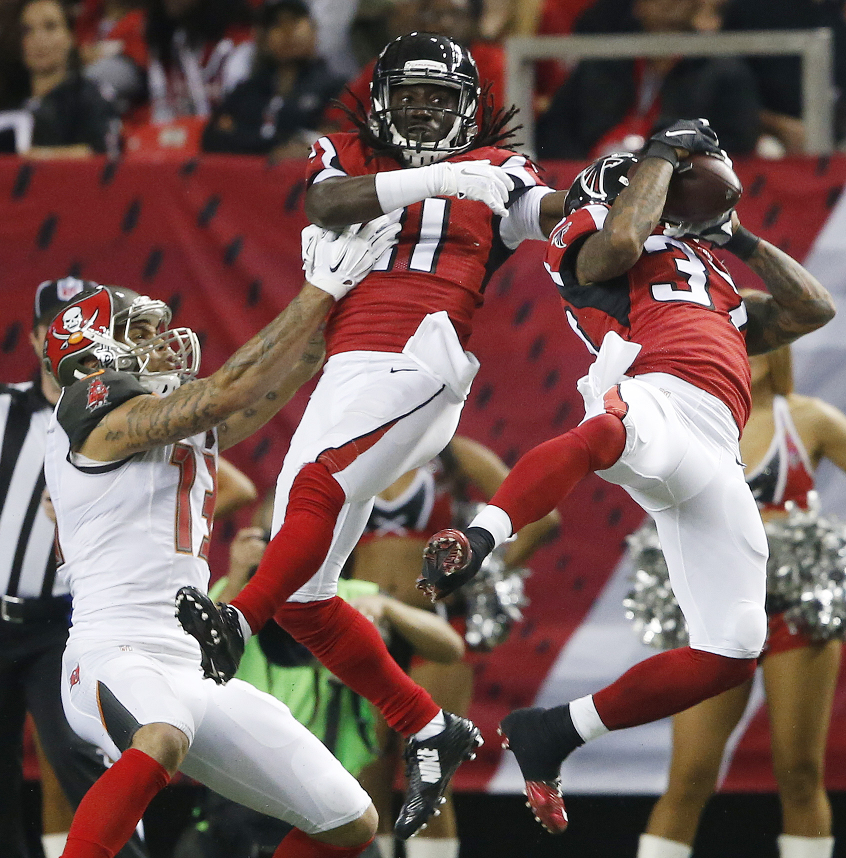 Tampa Bay Buccaneers wide receiver Mike Evans (13) waits for a thrown ball as Atlanta Falcons free safety Ricardo Allen (37) makes the catch and Falcons cornerback Desmond Trufant (21) looks on during the second of an NFL football game, Sunday, Nov. 1, 20