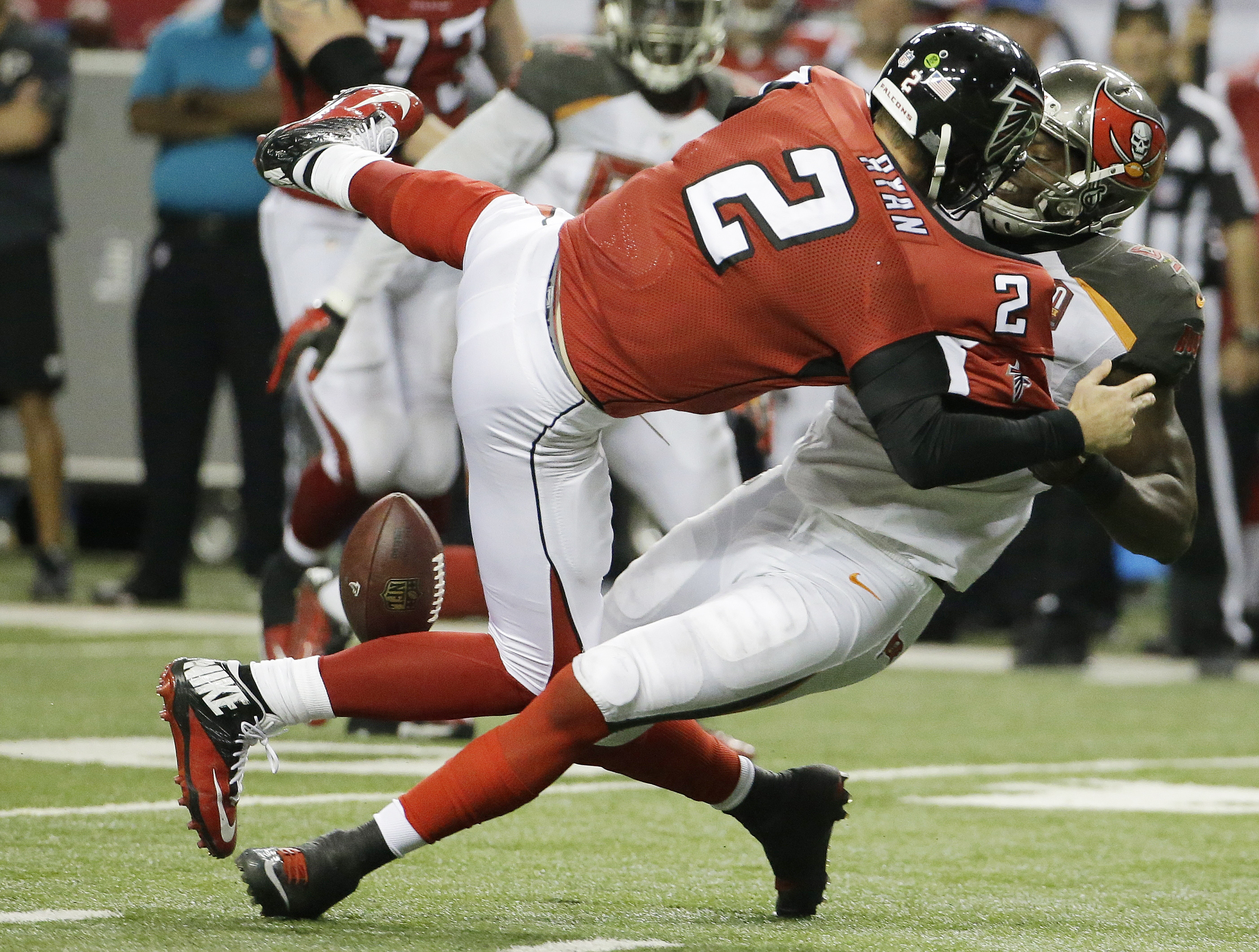 Tampa Bay Buccaneers defensive end Howard Jones (95) pulls at Atlanta Falcons quarterback Matt Ryan (2) causing a fumble during overtime of an NFL football game, Sunday, Nov. 1, 2015, in Atlanta. The Tampa Bay Buccaneers won 23-20. (AP Photo/David Goldman