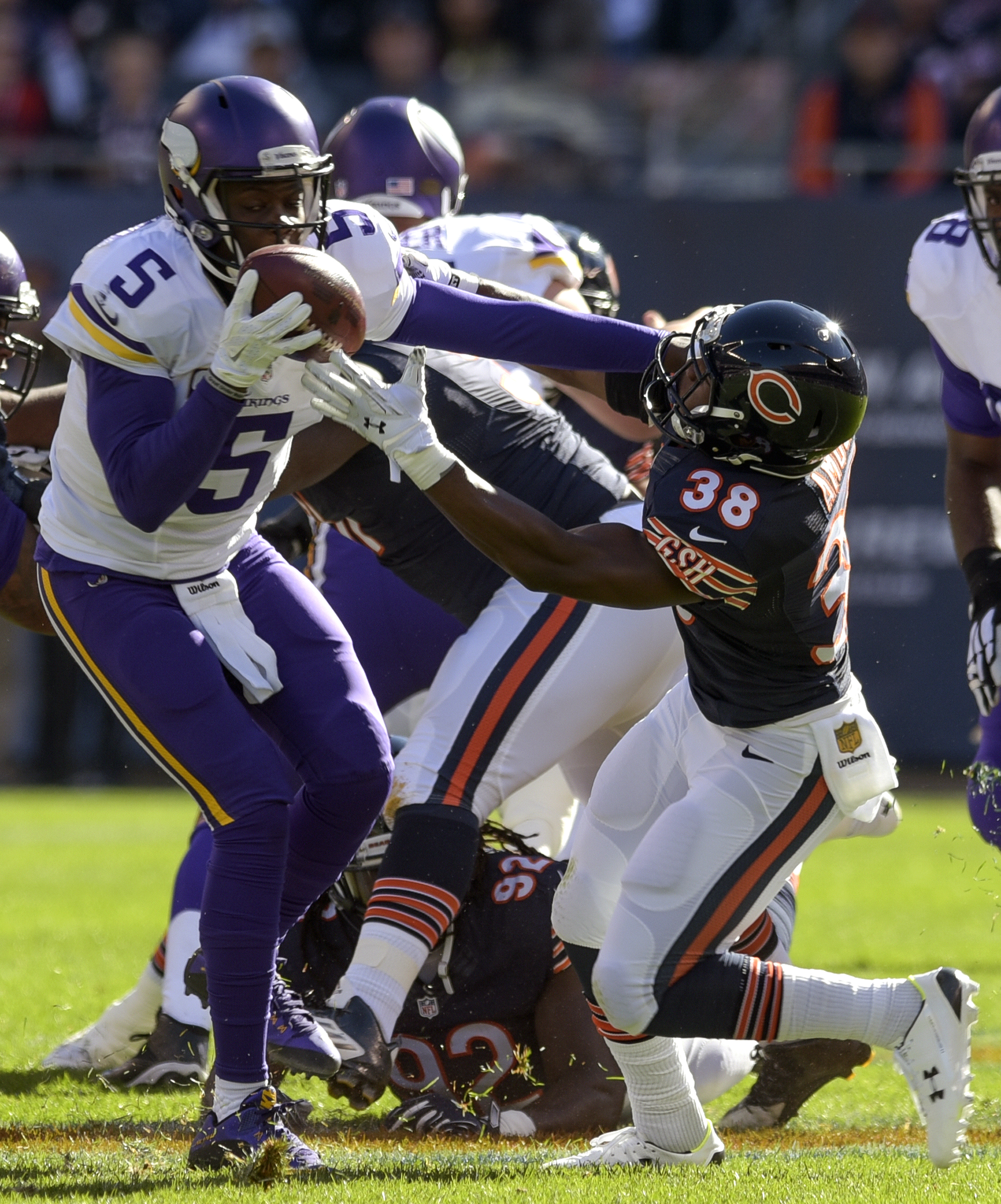 Minnesota Vikings quarterback Teddy Bridgewater (5) keeps the ball from Chicago Bears free safety Adrian Amos (38) during the first half of an NFL football game in Chicago, Sunday, Nov. 1, 2015. (Mark Black/Daily Herald via AP) MANDATORY CREDIT; MAGAZINES