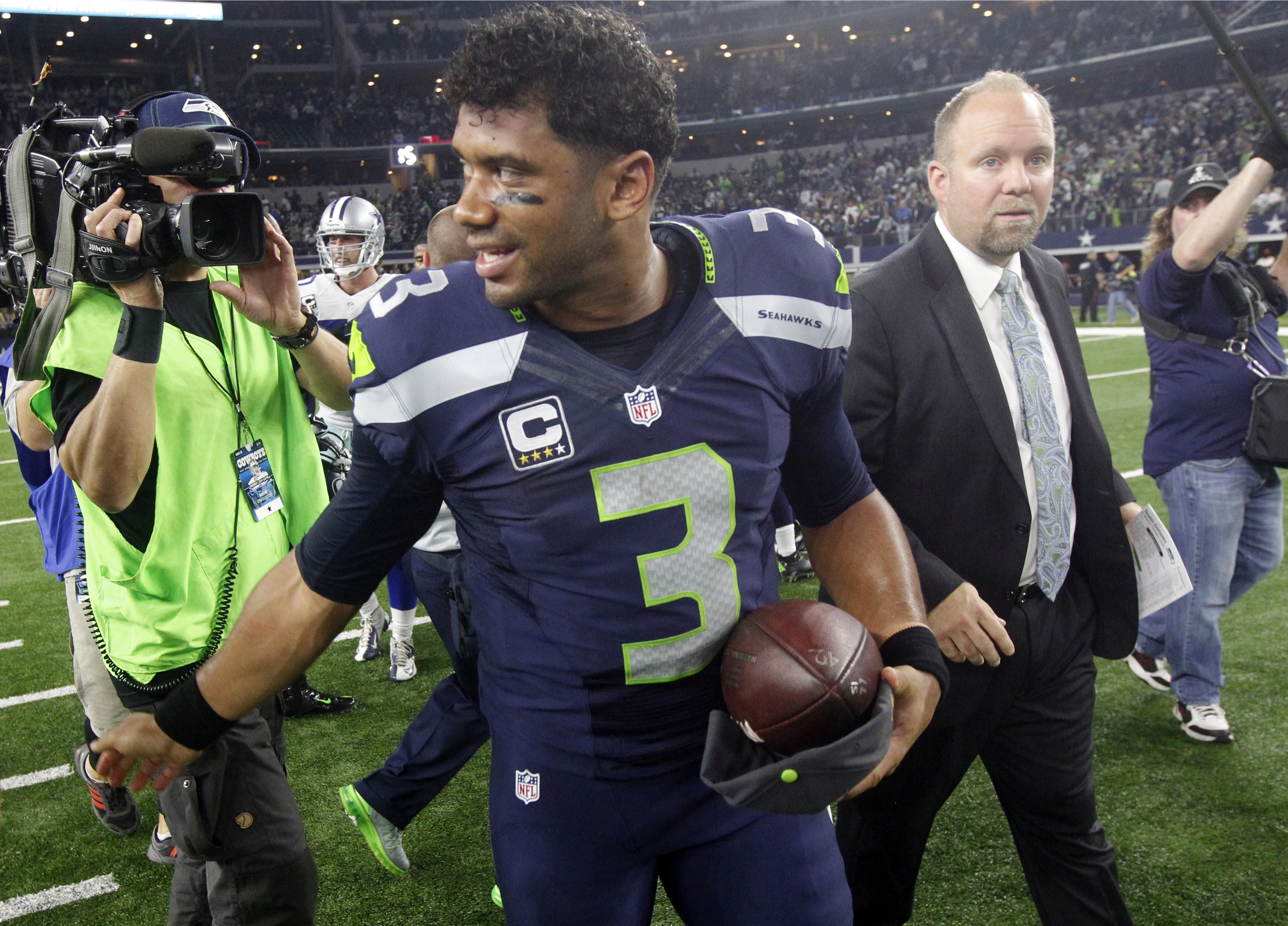 Seattle Seahawks' Russell Wilson (3) walks off the field after an NFL football game against the Dallas Cowboys, Sunday, Nov. 1, 2015, in Arlington, Texas. The Seahawks won 13-12. (AP Photo/Michael Ainsworth)