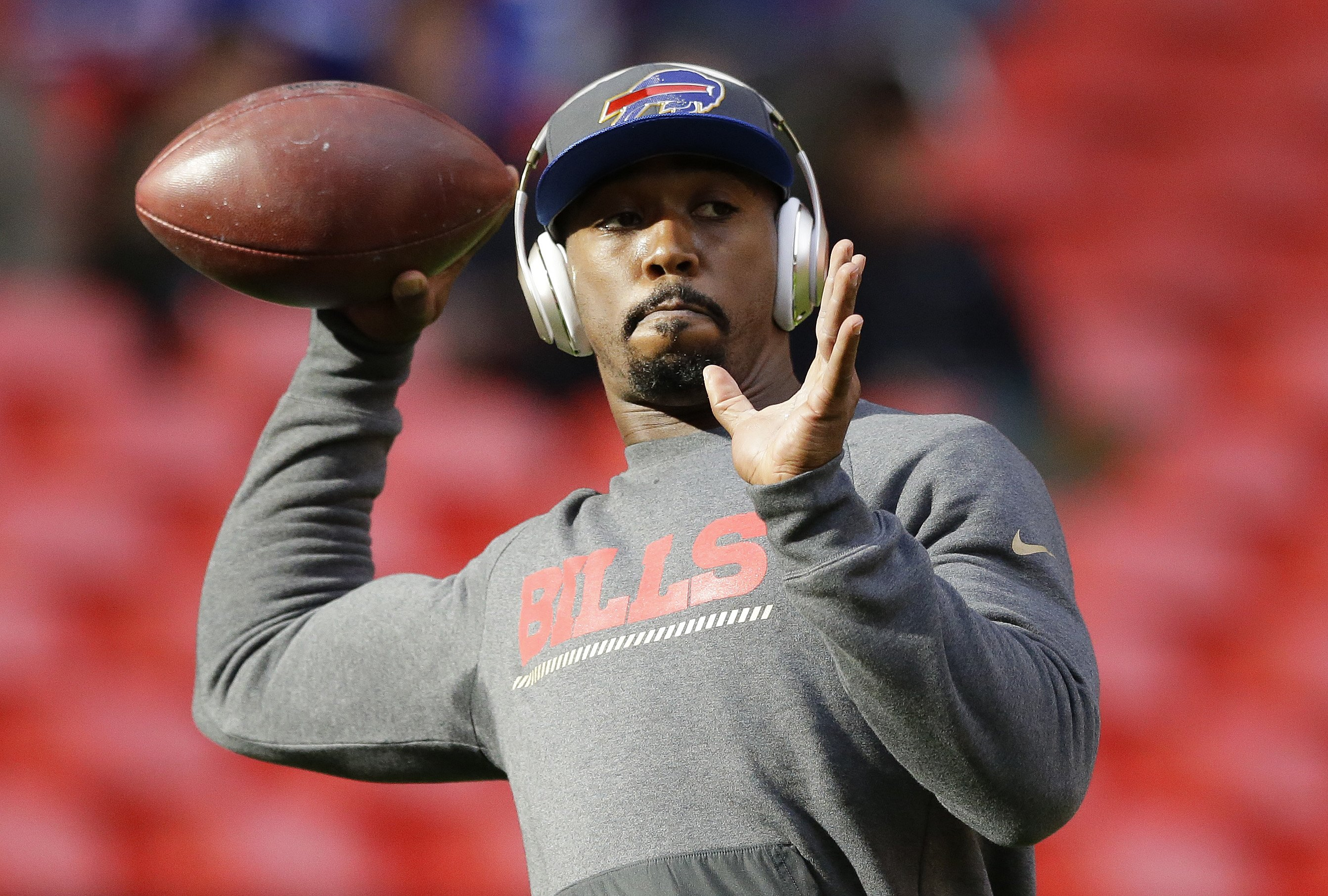 Buffalo Bills quarterback Tyrod Taylor (5) passes the ball during the warm-up before the NFL game between Buffalo Bills and Jacksonville Jaguars at Wembley Stadium in London,  Sunday, Oct. 25, 2015. Taylor is injured and will not play in the match. (AP Ph