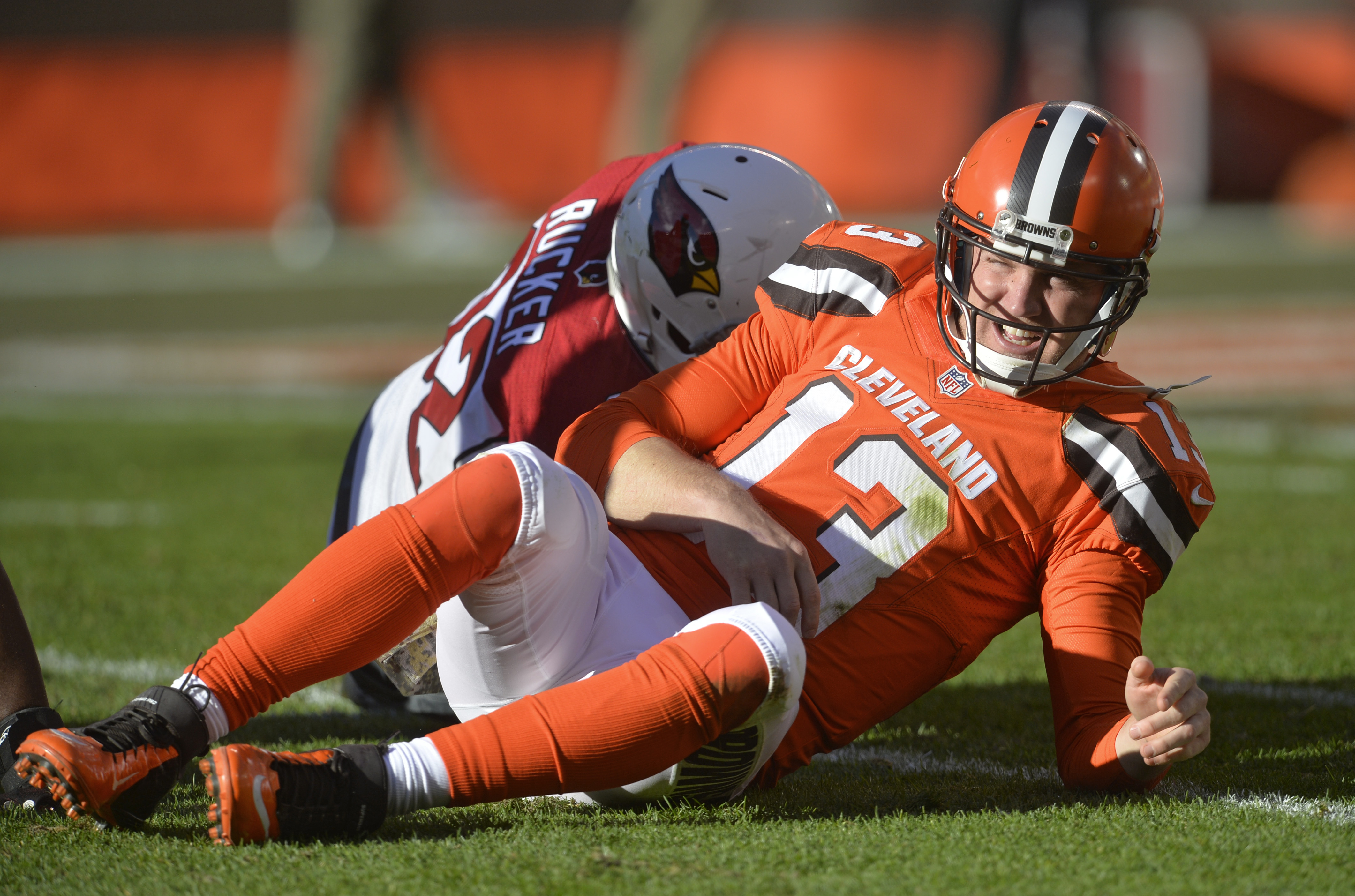 This Sunday, Nov. 1, 2015, photo shows Cleveland Browns quarterback Josh McCown getting up slowly after getting tackled by Arizona Cardinals defensive end Frostee Rucker in an NFL football game, in Cleveland.  Browns coach Mike Pettine says McCown is sore