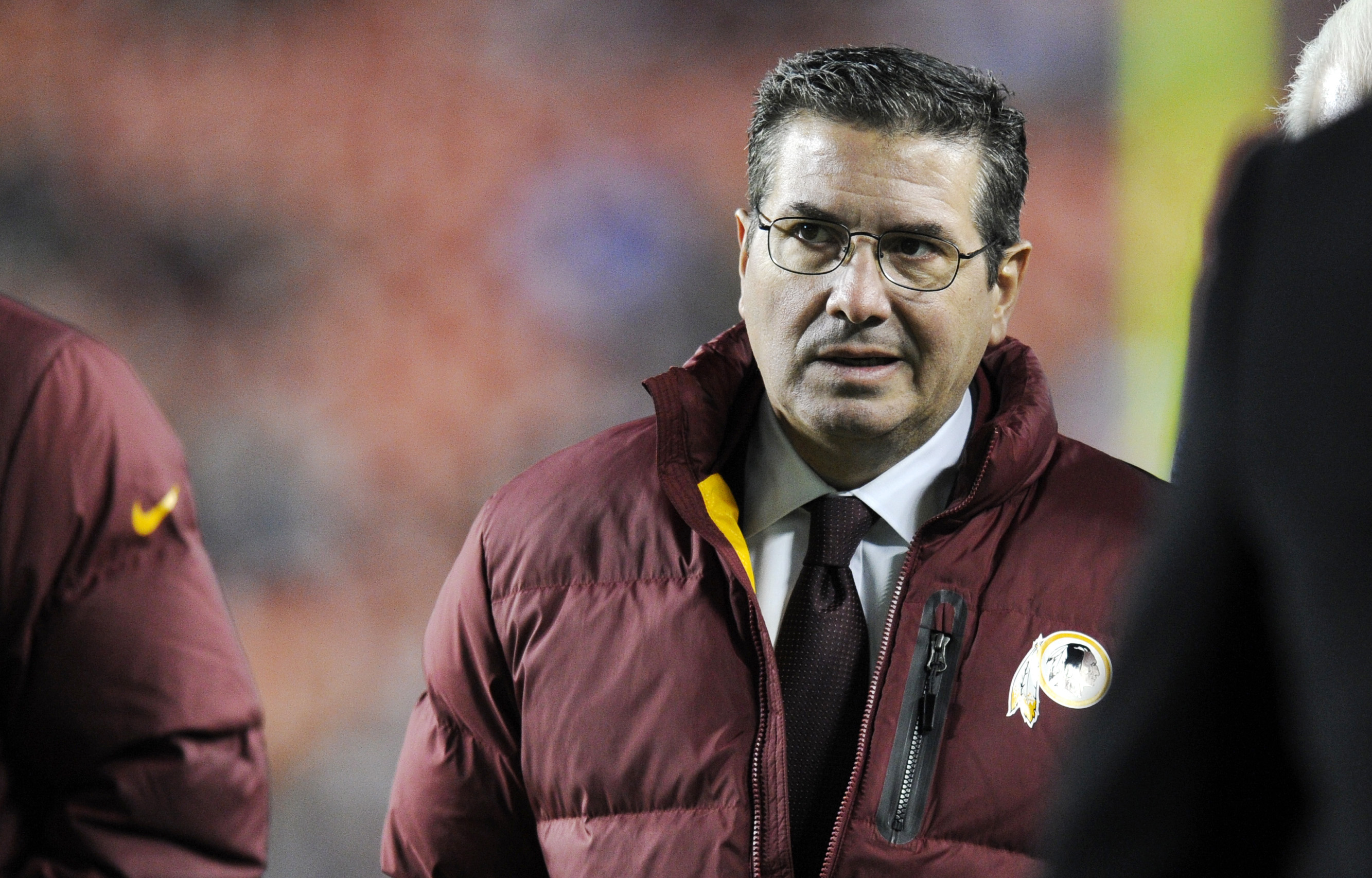 FILE - In this Dec. 1, 2013, file photo, Washington Redskins owner Dan Snyder walks off the field before an NFL football game against the New York Giants in Landover, Md. Washington Redskins owner Dan Snyder said Tuesday, April 22, 2014, it's time for peo