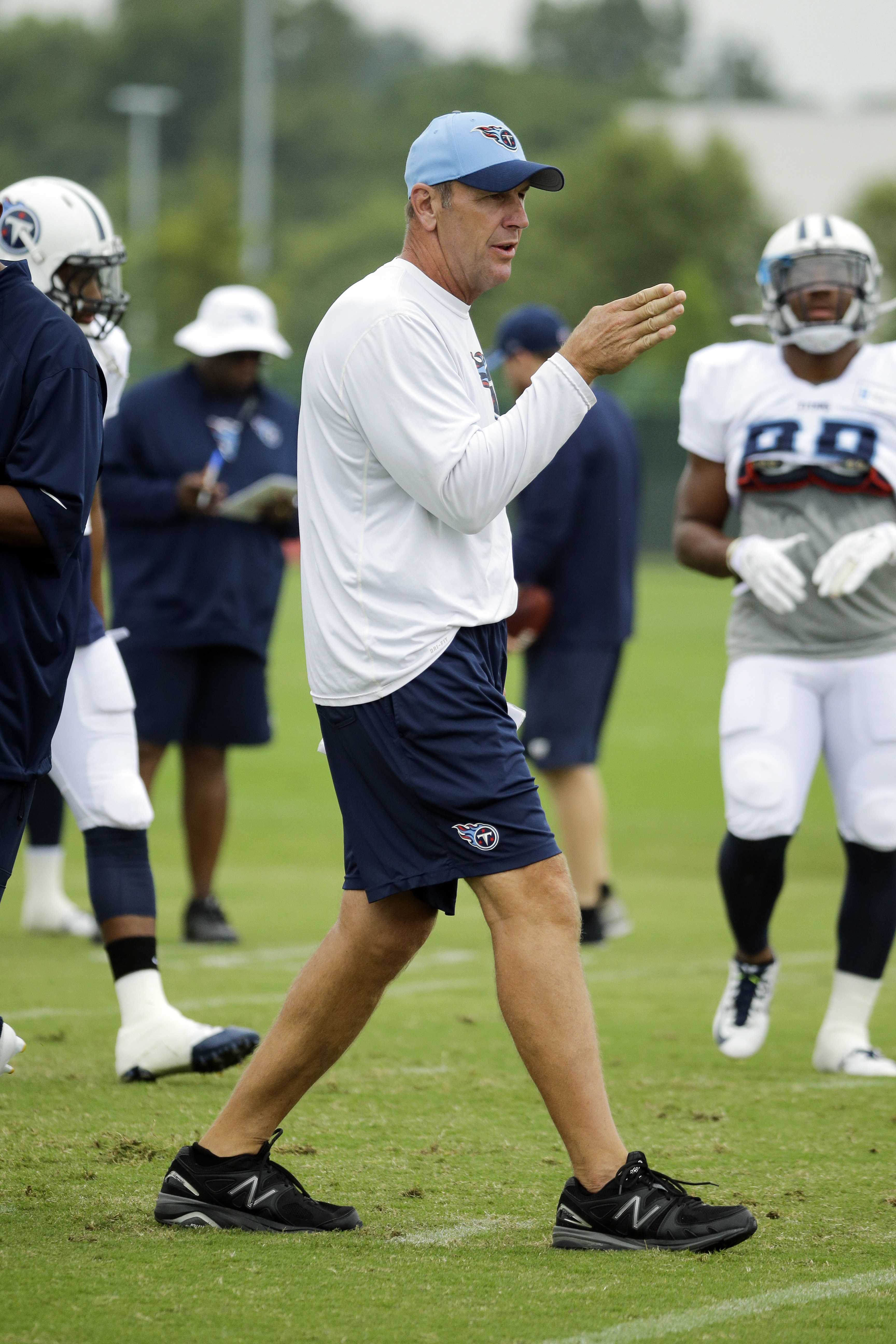CORRECTS DATE TO 2015 - FILE - In this Aug. 7, 2015, file photo, Tennessee Titans assistant head coach for tight ends Mike Mularkey directs his players during NFL football training camp in Nashville, Tenn. The Titans have fired head coach Ken Whisenhunt a