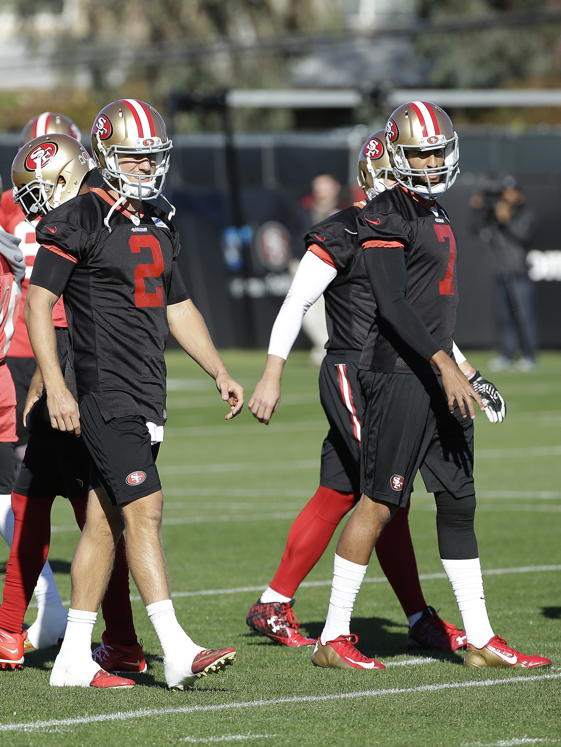 San Francisco 49ers quarterback Blaine Gabbert (2) and quarterback Colin Kaepernick (7) participate in drills during an NFL football practice in Santa Clara, Calif., Wednesday, Nov. 4, 2015. Head coach Jim Tomsula announced that the 49ers have officially