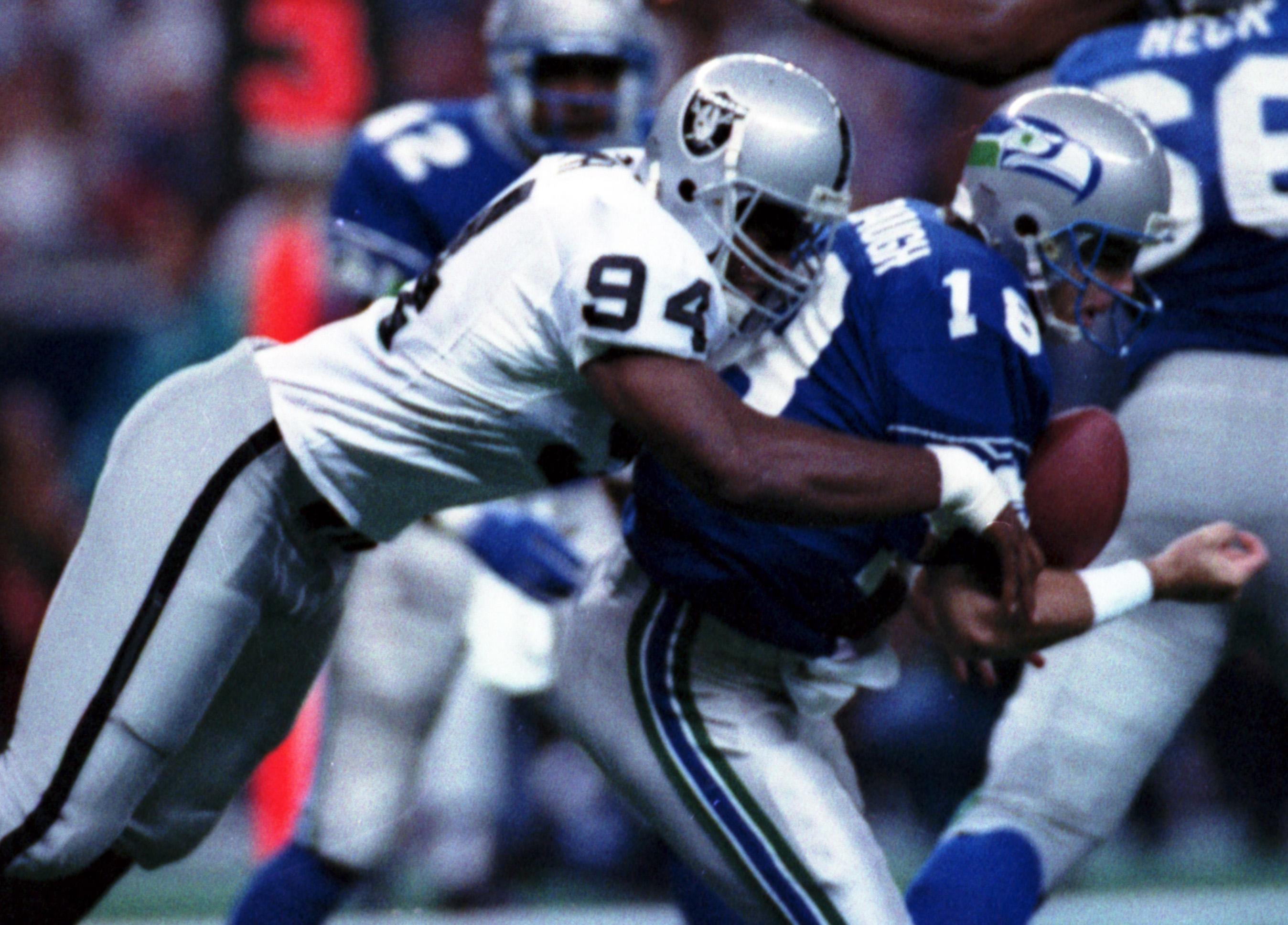 FILE - In this Oct. 18, 1992, file photo, Los Angeles Raiders' Anthony Smith (94) sacks Seattle Seahawks quarterback Stan Gelbaugh during the second quarter of an NFL football game in Seattle. Smith, a former defensive end with the Oakland and Los Angeles