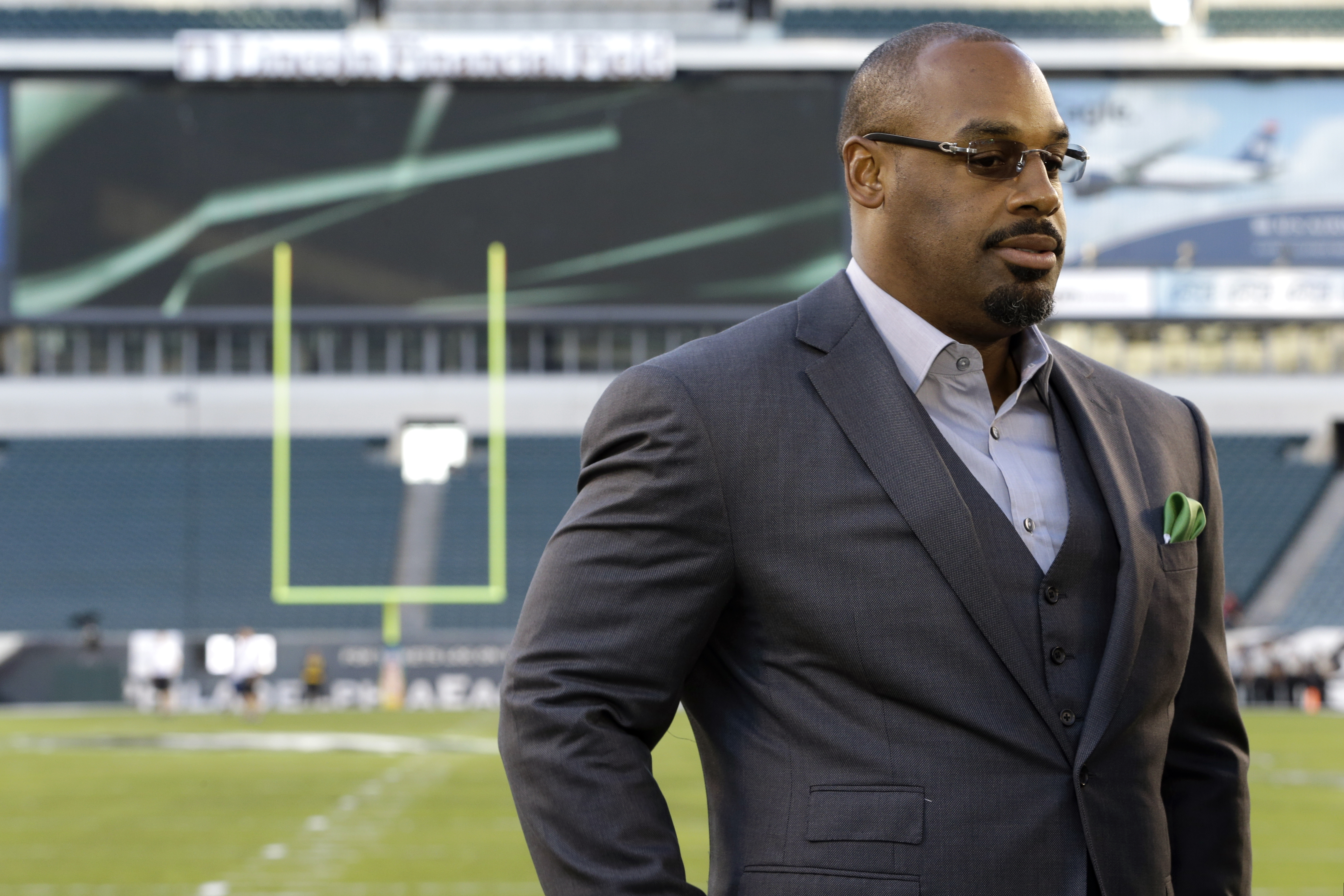 FILE - In this Sept. 19, 2013, file photo, former Philadelphia Eagles quarterback Donovan McNabb pauses during a television interview before an NFL football game against the Kansas City Chiefs, in Philadelphia. McNabb will serve 18 days in an Arizona jail