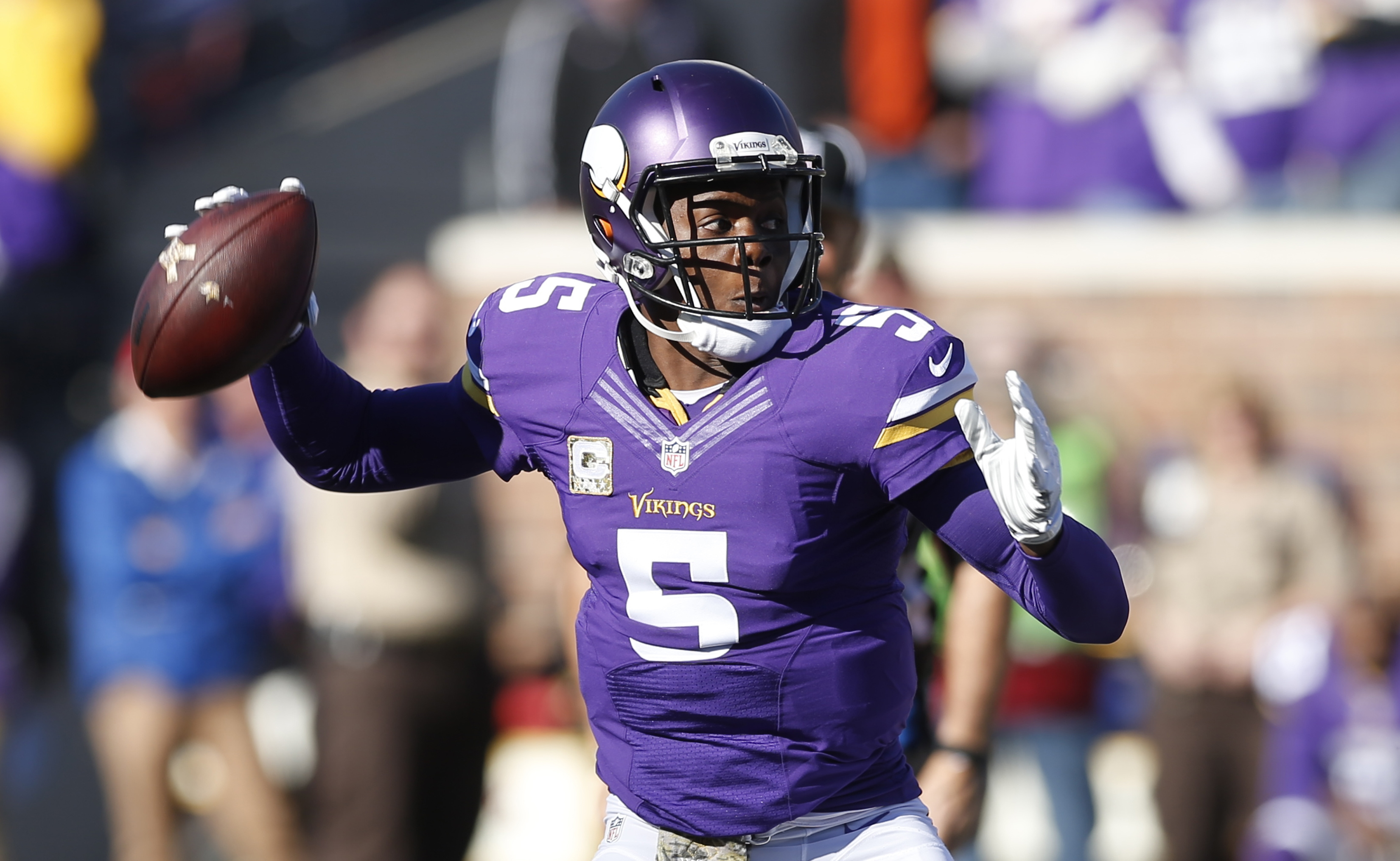 Minnesota Vikings quarterback Teddy Bridgewater prepares to throw during the first half of an NFL football game against the St. Louis Rams, Sunday, Nov. 8, 2015, in Minneapolis. (AP Photo/Jim Mone)