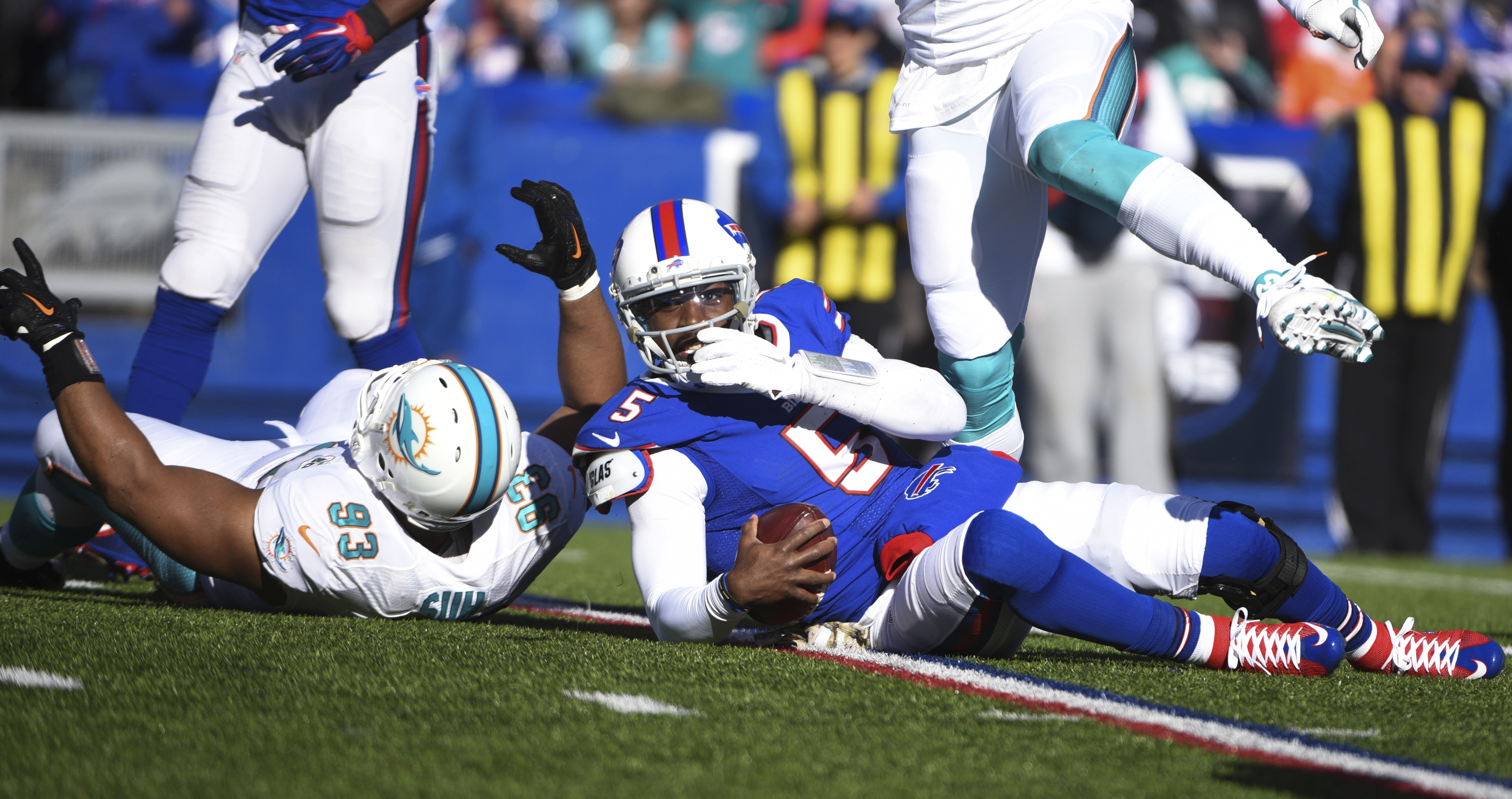 Buffalo Bills quarterback Tyrod Taylor (5) reacts after being sacked by Miami Dolphins' Ndamukong Suh (93) during the first half of an NFL football game Sunday, Nov. 8, 2015, in Orchard Park, N.Y. (AP Photo/Gary Wiepert)