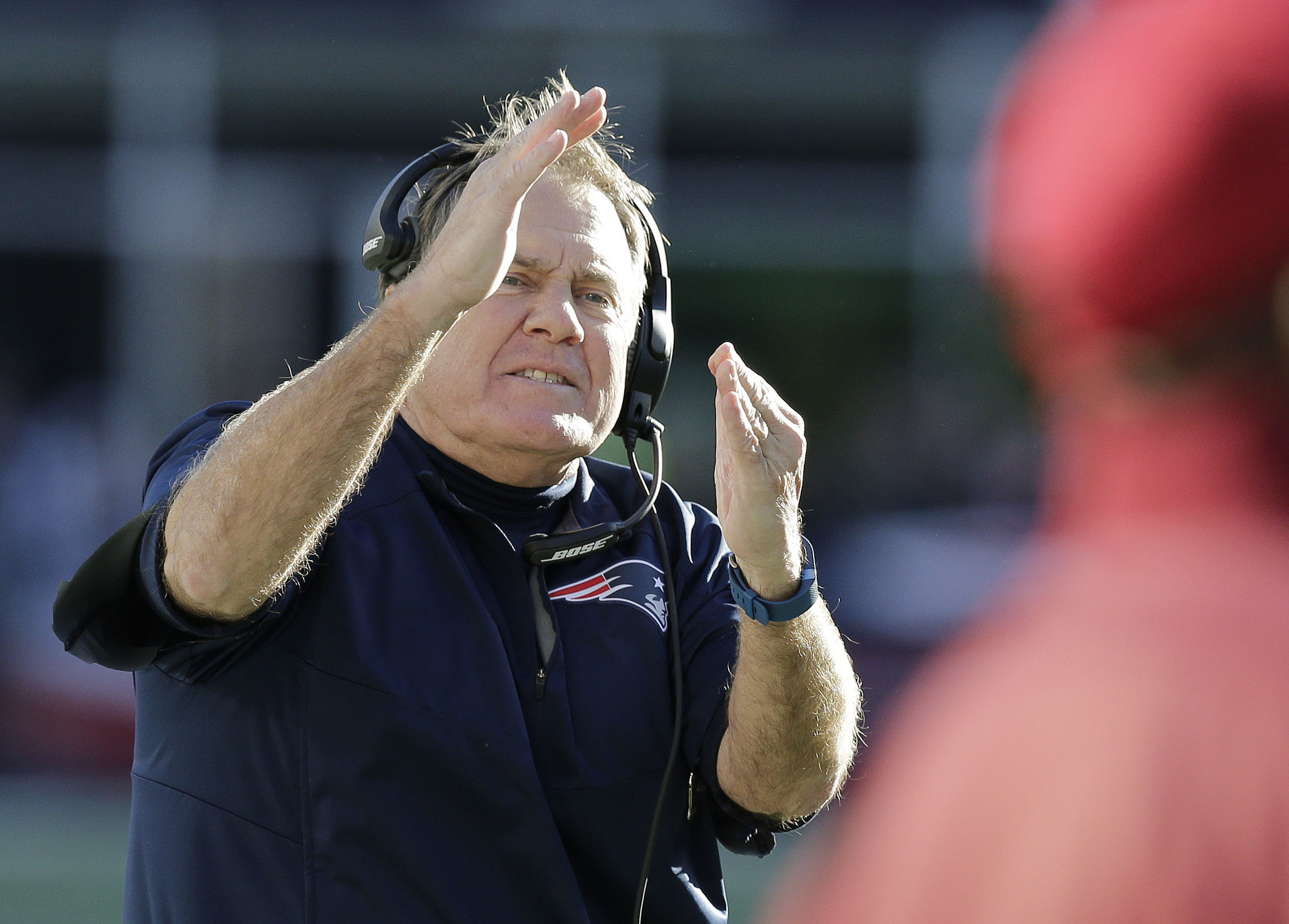 New England Patriots head coach Bill Belichick signals an official asking for a time out during the first half of an NFL football game against the Washington Redskins, Sunday, Nov. 8, 2015, in Foxborough, Mass. (AP Photo/Charles Krupa)