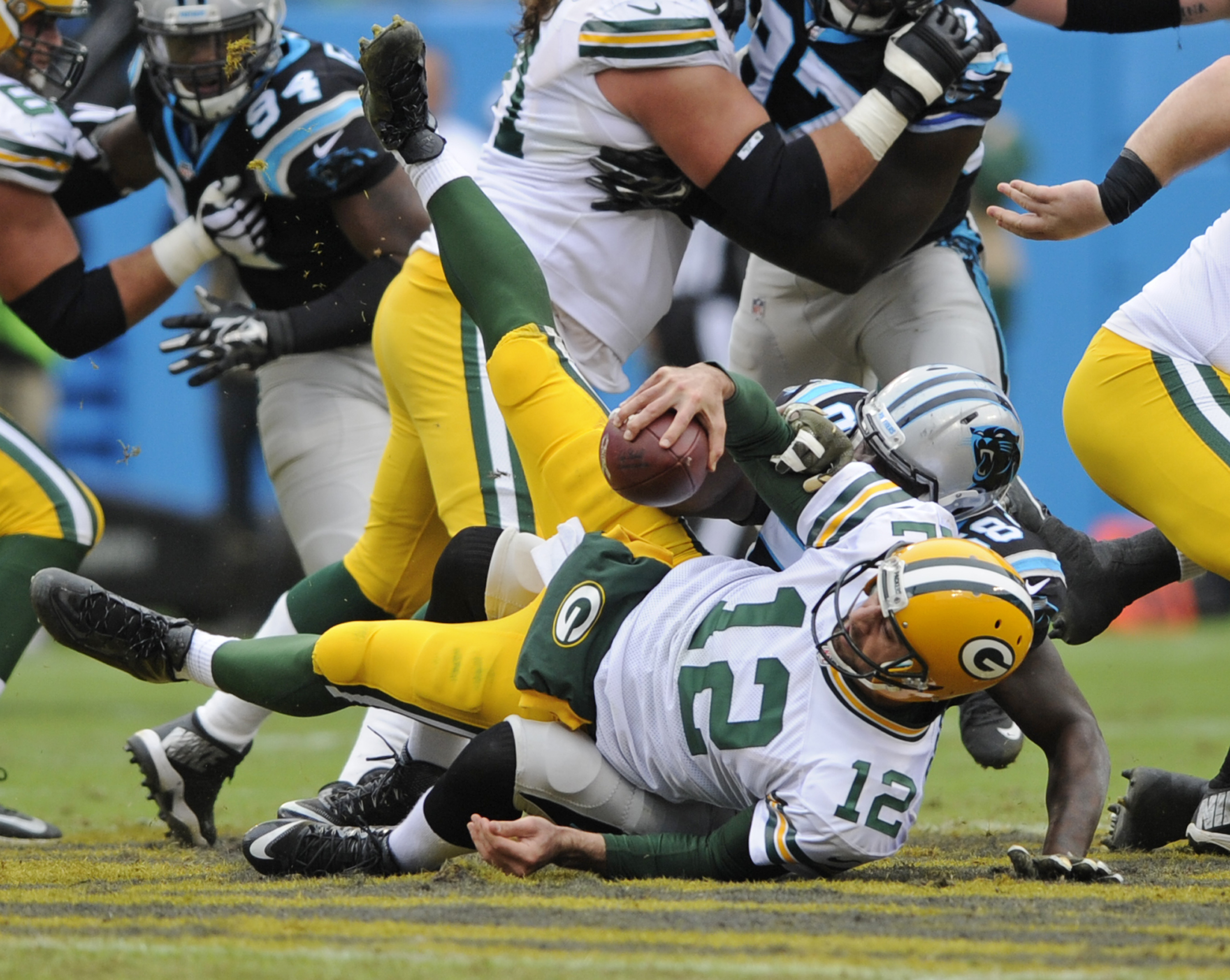 Green Bay Packers' Aaron Rodgers (12) is sacked by Carolina Panthers' Thomas Davis (58) in the first half of an NFL football game in Charlotte, N.C., Sunday, Nov. 8, 2015. (AP Photo/Mike McCarn)