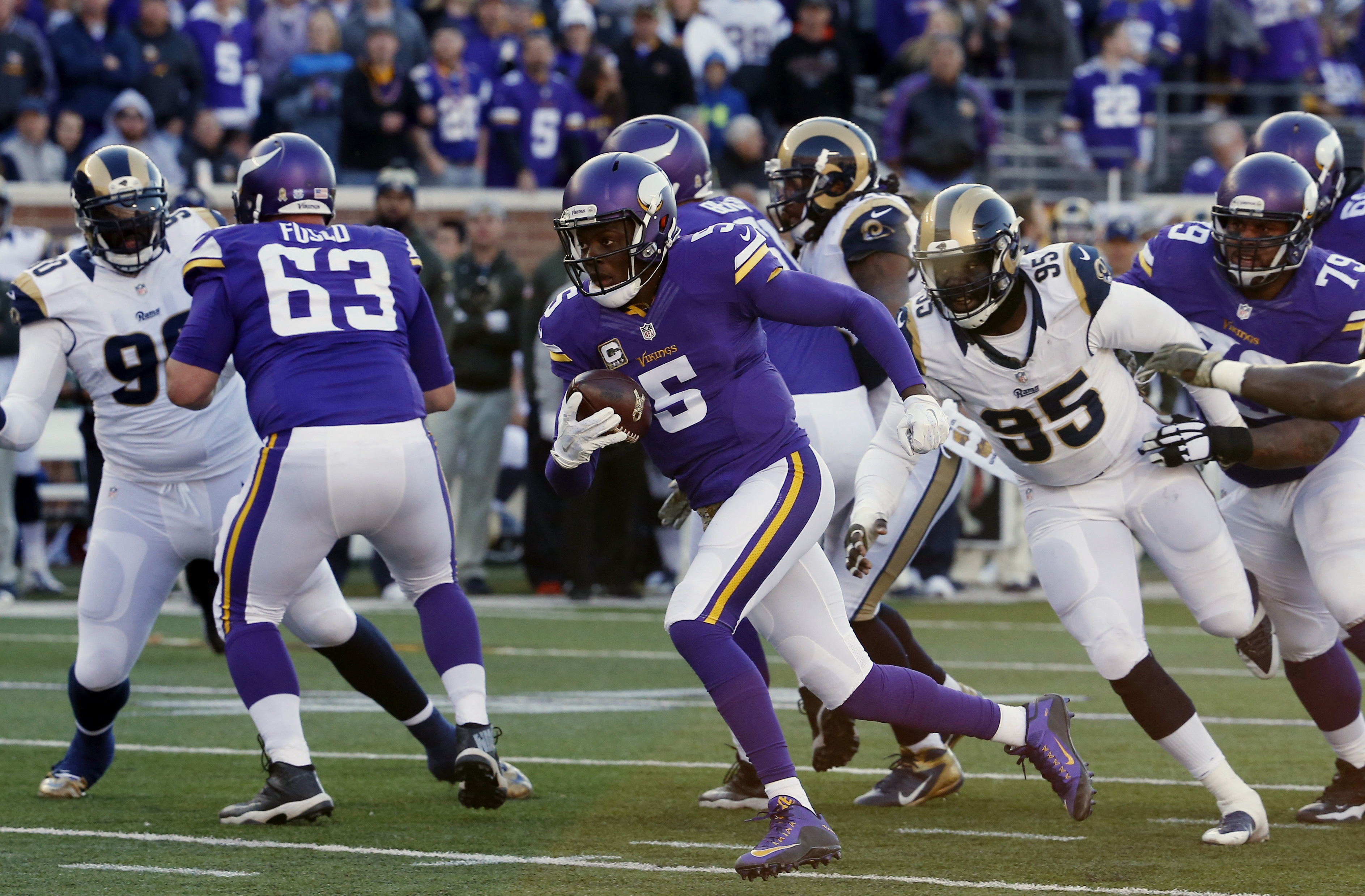Minnesota Vikings quarterback Teddy Bridgewater (5) breaks away from St. Louis Rams defensive end William Hayes (95) for a touchdown run during the second half of an NFL football game Sunday, Nov. 8, 2015, in Minneapolis. (AP Photo/Ann Heisenfelt)