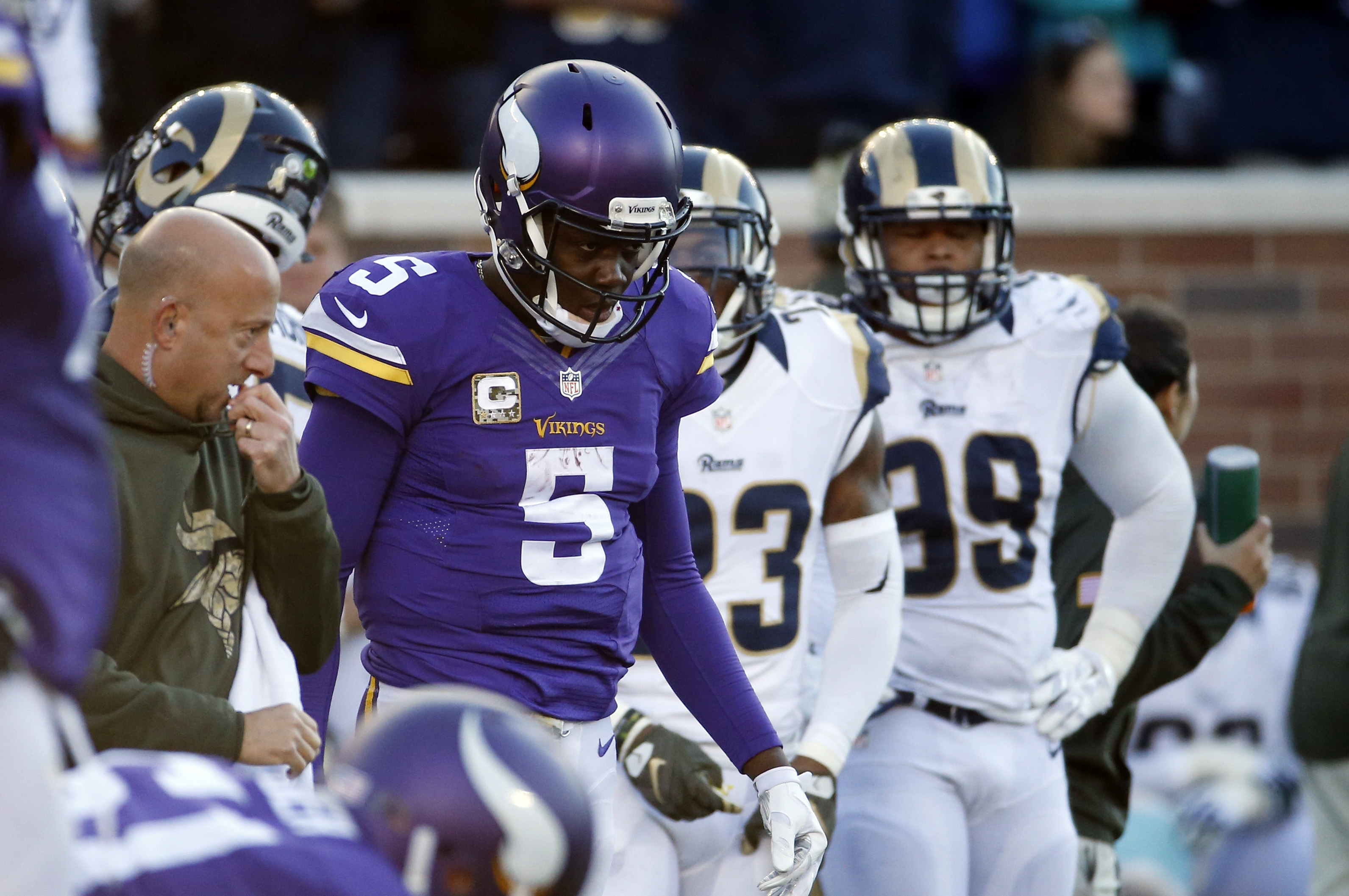 Minnesota Vikings quarterback Teddy Bridgewater (5) walks back to the bench after being examined on the field during the second half of an NFL football game against the St. Louis Rams, Sunday, Nov. 8, 2015, in Minneapolis. (AP Photo/Ann Heisenfelt)