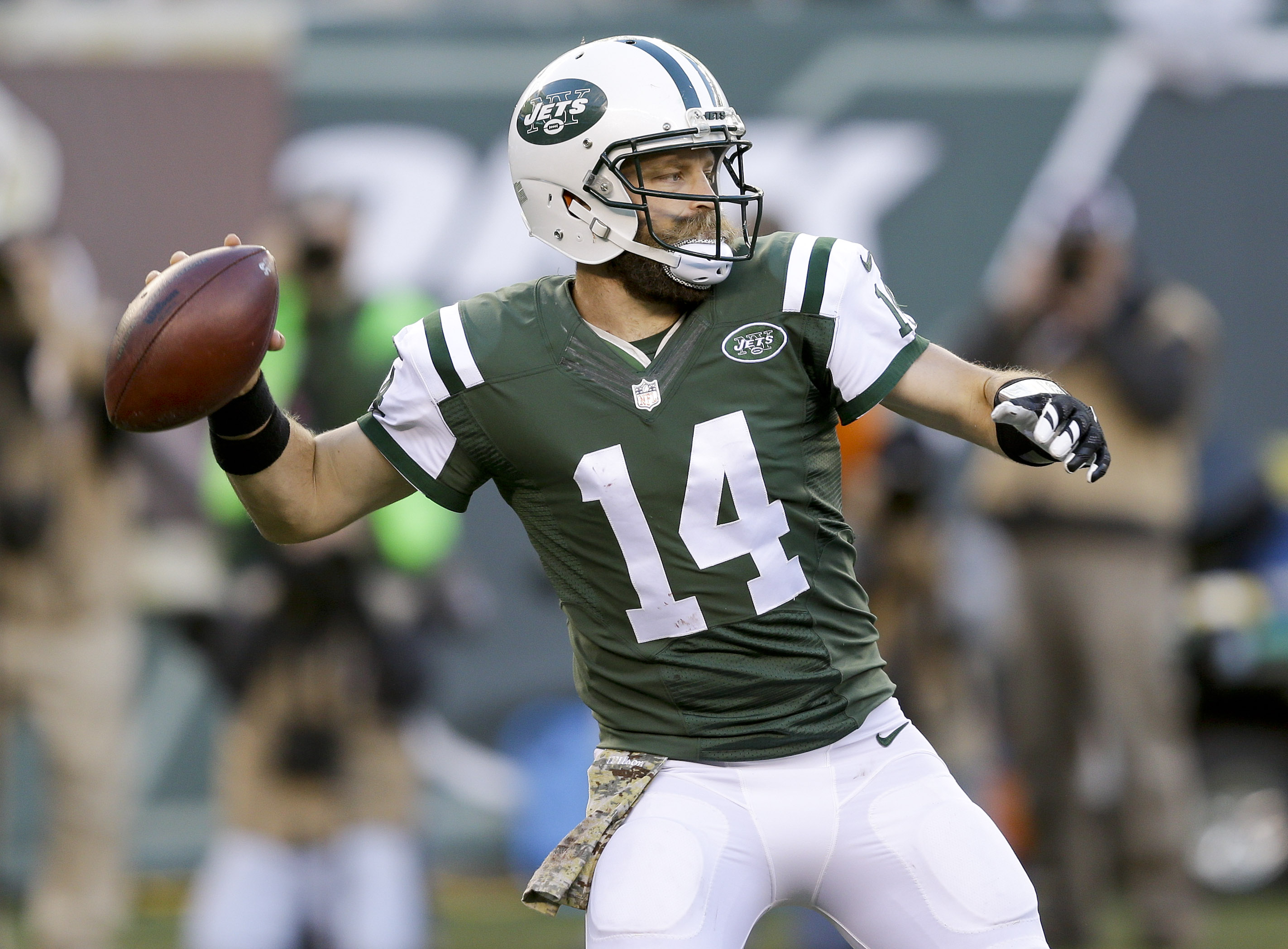 New York Jets quarterback Ryan Fitzpatrick (14) passes against the Jacksonville Jaguars during the fourth quarter of an NFL football game, Sunday, Nov. 8, 2015, in East Rutherford, N.J. The Jets won 28-23. (AP Photo/Seth Wenig)