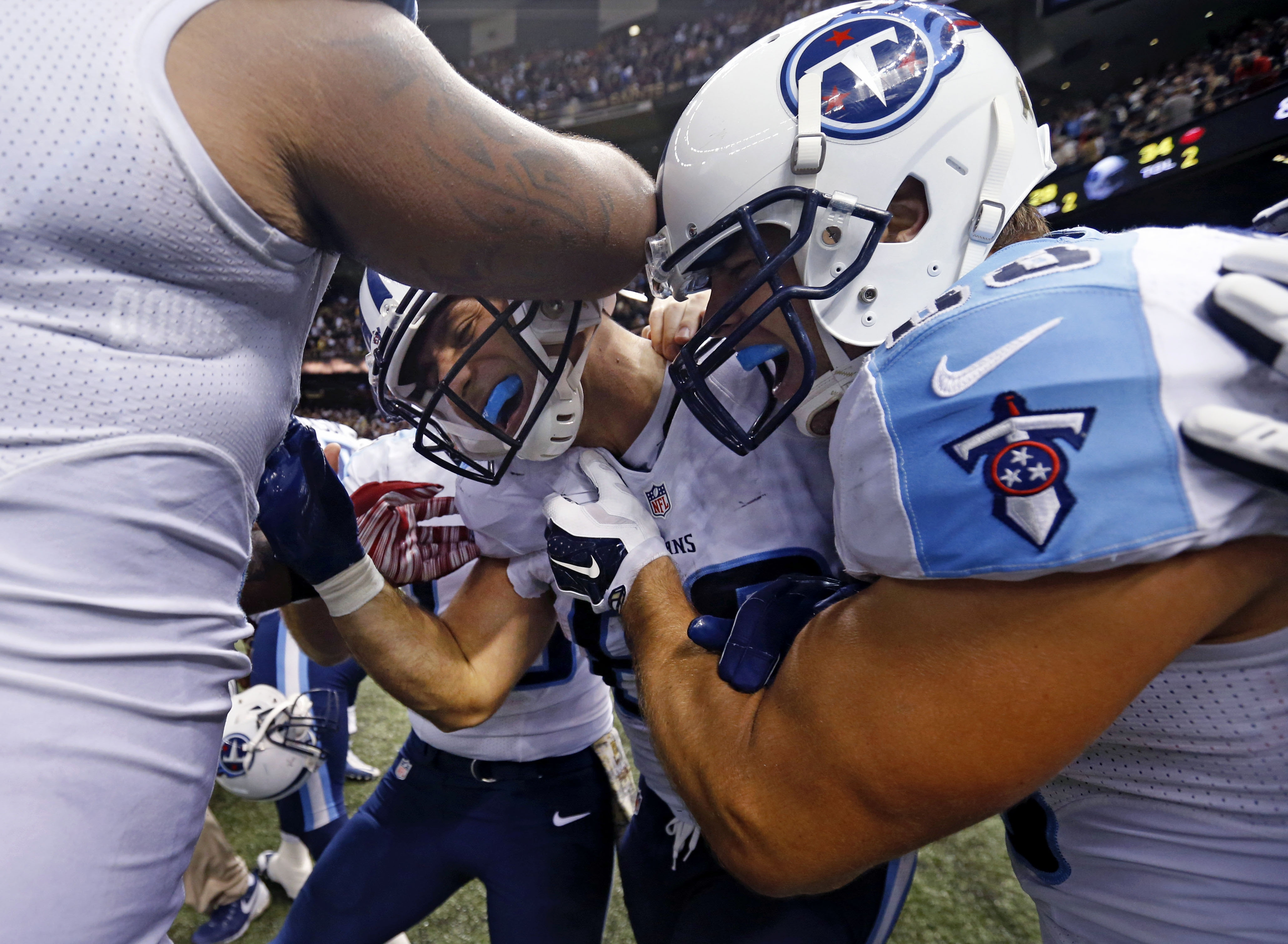 Tennessee Titans tight end Anthony Fasano is mobbed by teammates after catching the game wining touchdown during overtime of an NFL football game against the New Orleans Saints in New Orleans, Sunday, Nov. 8, 2015. The Titans won 34-28. (AP Photo/Jonathan