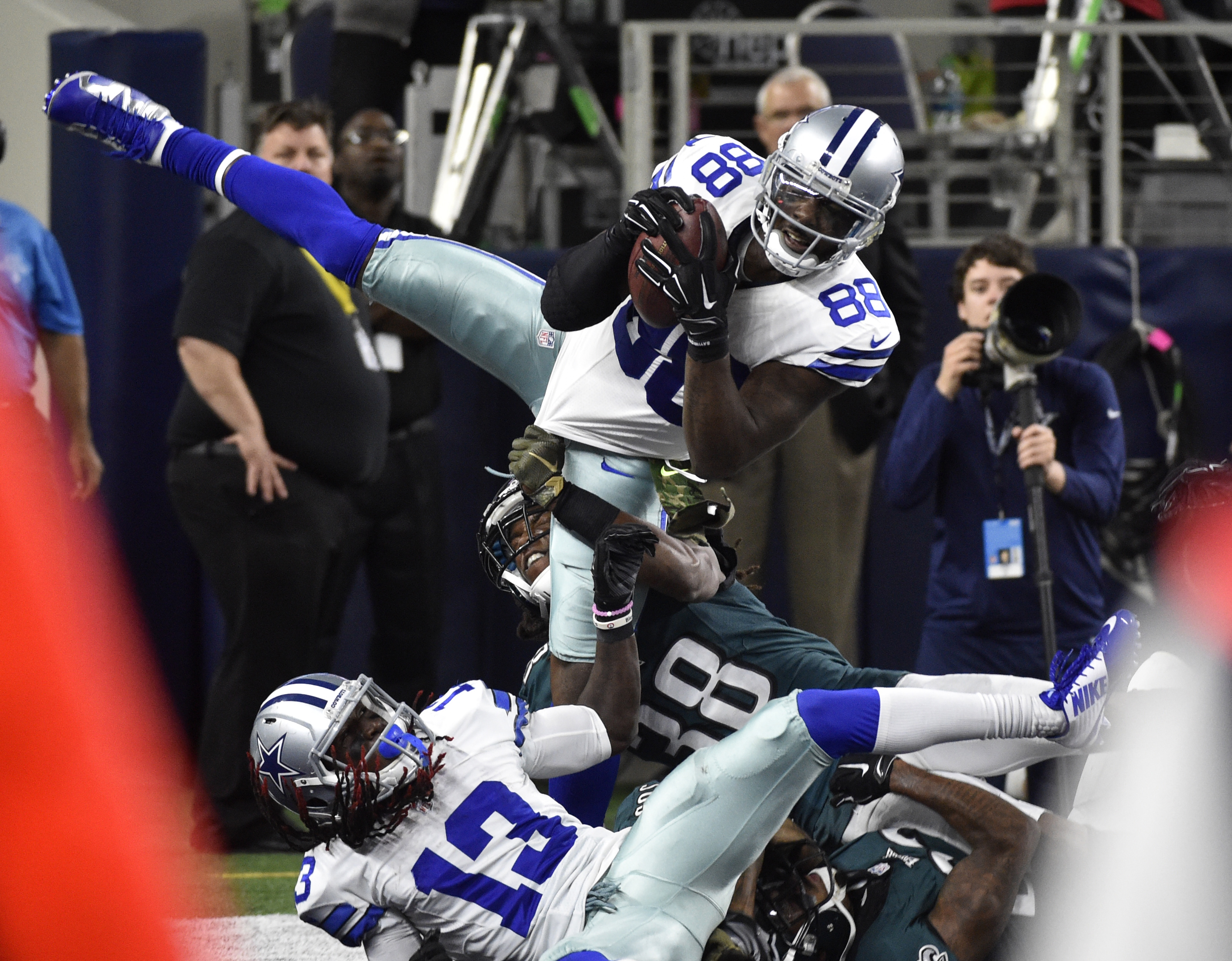 Dallas Cowboys' Dez Bryant (88) comes down with a touchdown catch over Philadelphia Eagles' E.J. Biggers (38) in the end  zone in the second half of an NFL football game, Sunday, Nov. 8, 2015, in Arlington, Texas. The Cowboy's Lucky Whitehead (13) and oth