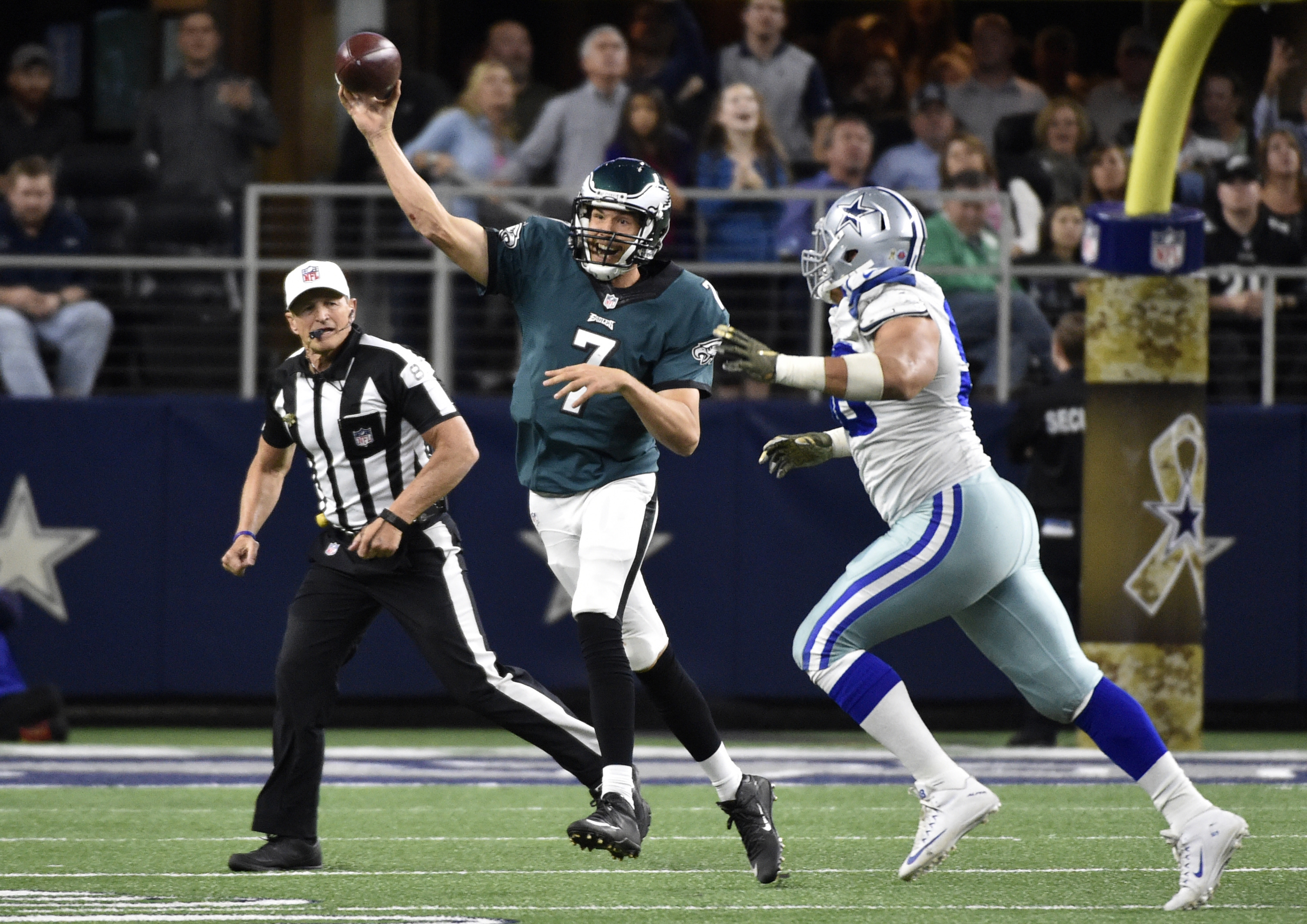 Philadelphia Eagles' Sam Bradford (7) throws a pass as Dallas Cowboys defensive tackle Tyrone Crawford defends in the second half of an NFL football game Sunday, Nov. 8, 2015, in Arlington, Texas. (AP Photo/Michael Ainsworth)