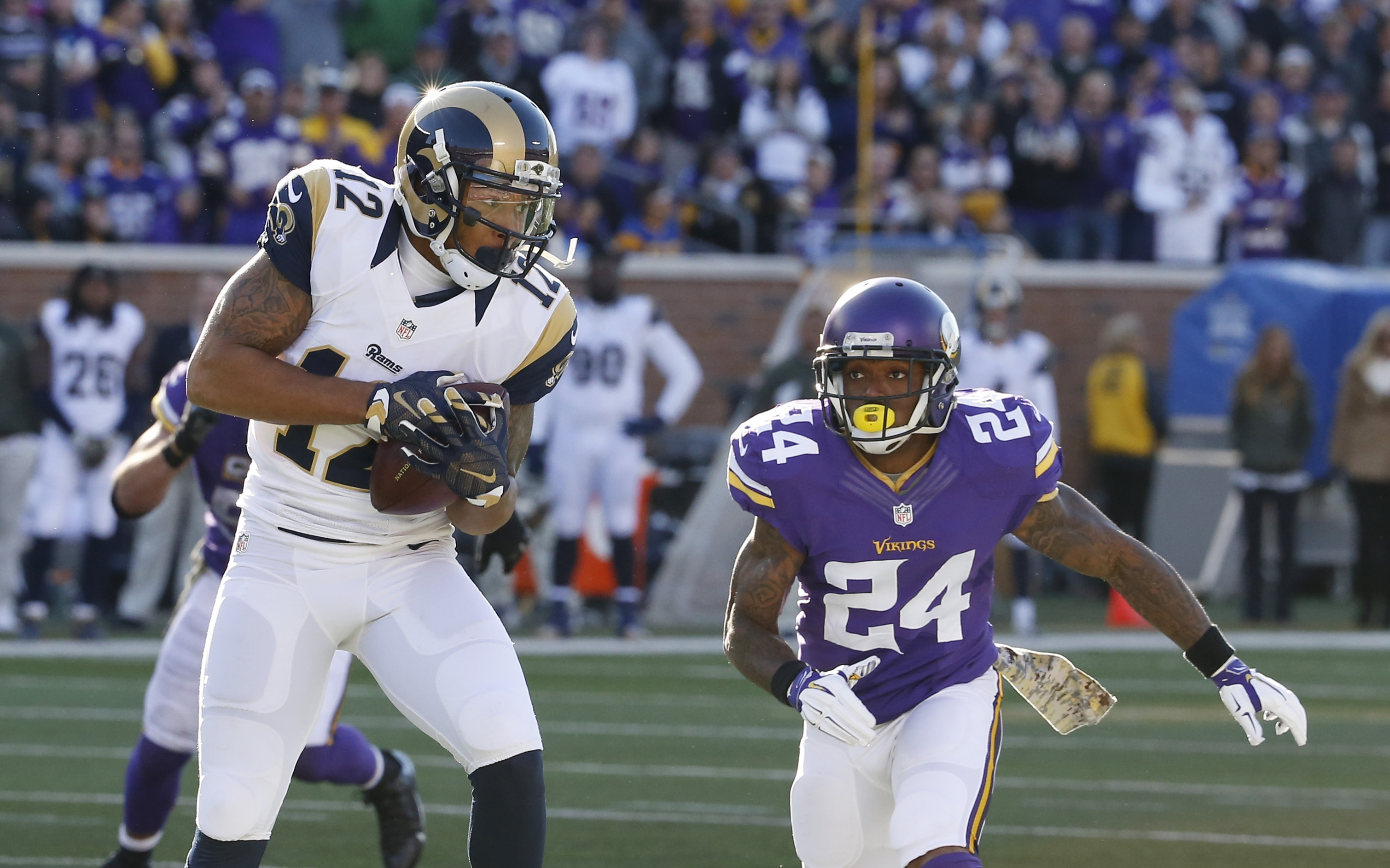 Minnesota Vikings cornerback Captain Munnerlyn (24) closes in on St. Louis Rams wide receiver Stedman Bailey (12) during the second half of an NFL football game, Sunday, Nov. 8, 2015, in Minneapolis. (AP Photo/Ann Heisenfelt)