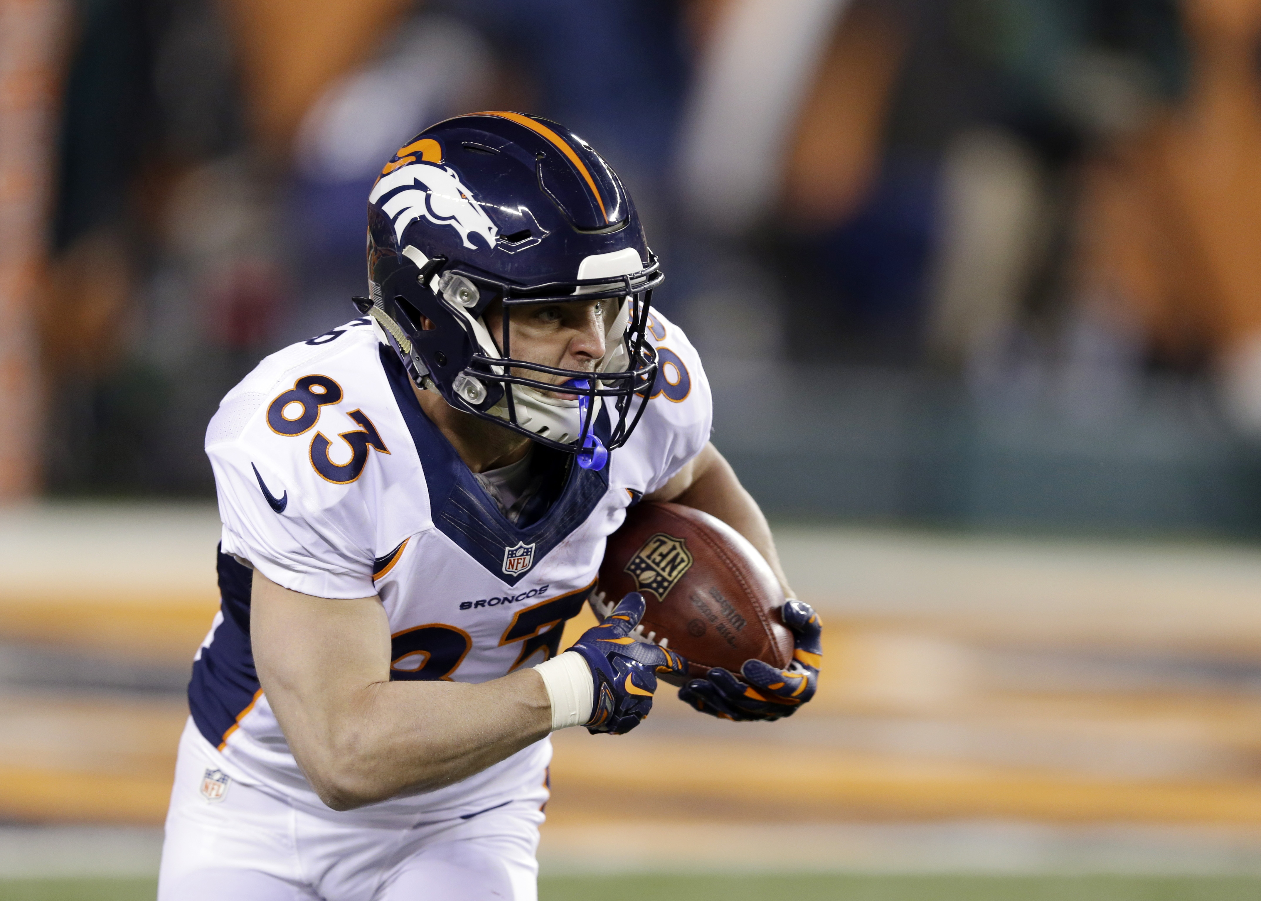 Denver Broncos wide receiver Wes Welker runs with a catch against the Cincinnati Bengals during the first half of an NFL football game Monday, Dec. 22, 2014, in Cincinnati. (AP Photo/Michael Conroy)