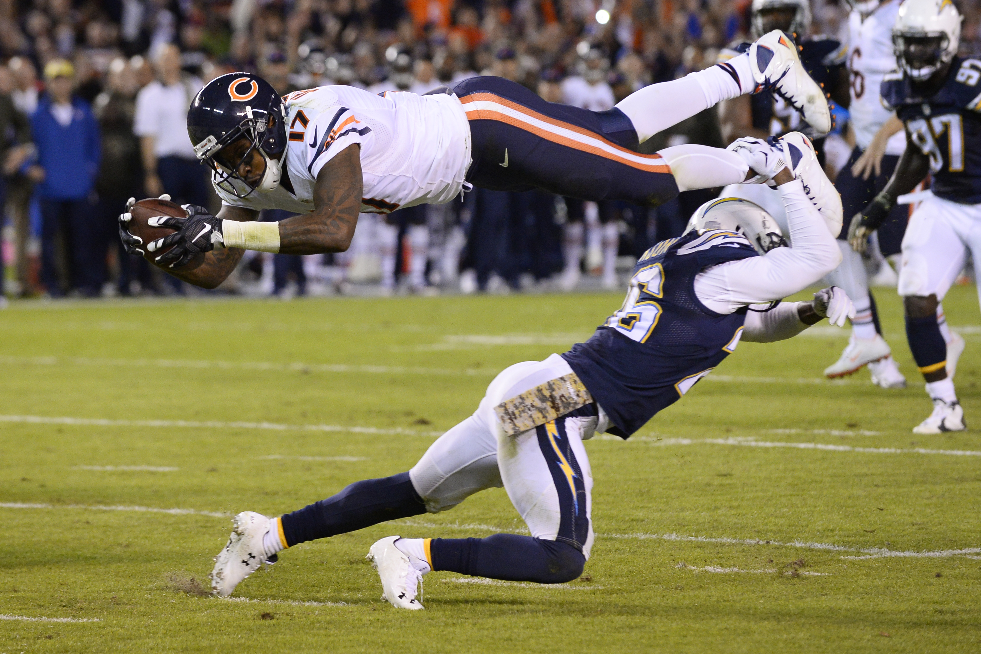 Chicago Bears wide receiver Alshon Jeffery, above, is stopped near the goal line by San Diego Chargers cornerback Patrick Robinson, below, during the first half of an NFL football game Monday, Nov. 9, 2015, in San Diego. (AP Photo/Denis Poroy)